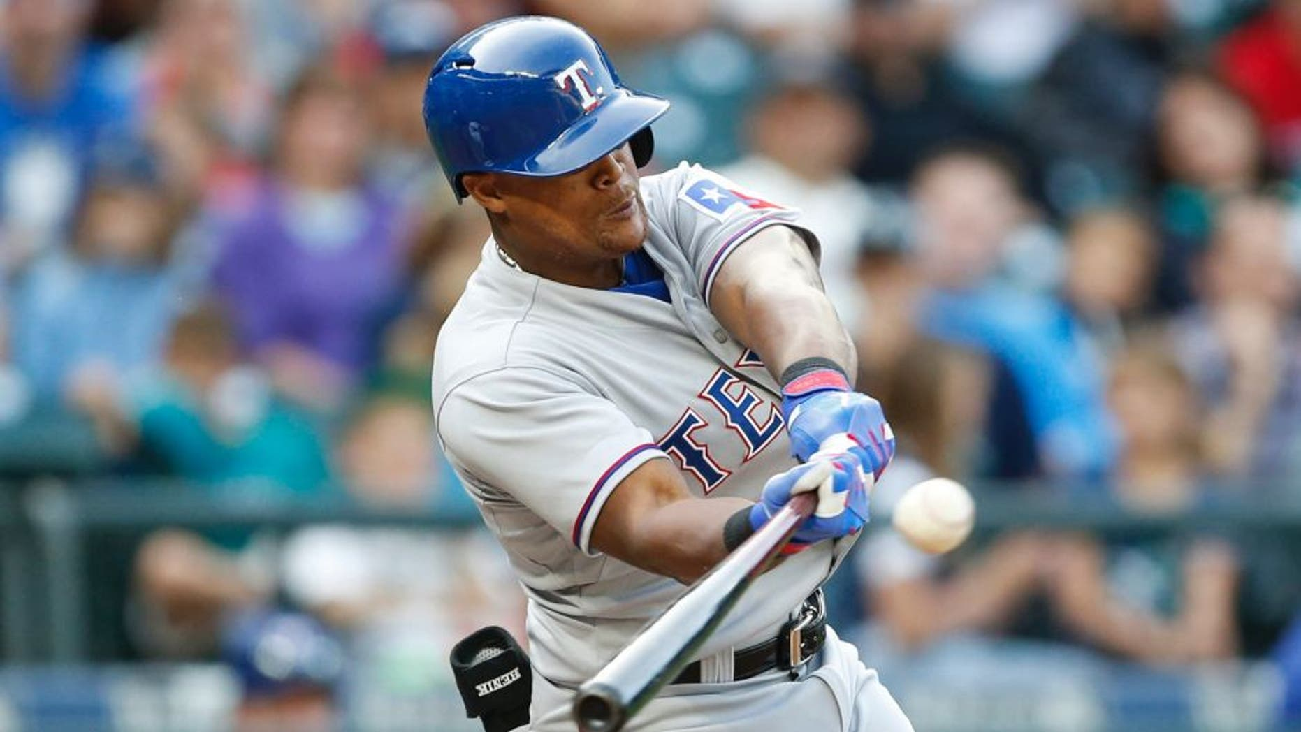 Sep 7, 2015; Seattle, WA, USA; Texas Rangers third baseman Adrian Beltre (29) hits a two-run RBI single in the sixth inning against the Seattle Mariners at Safeco Field. Mandatory Credit: Jennifer Buchanan-USA TODAY Sports