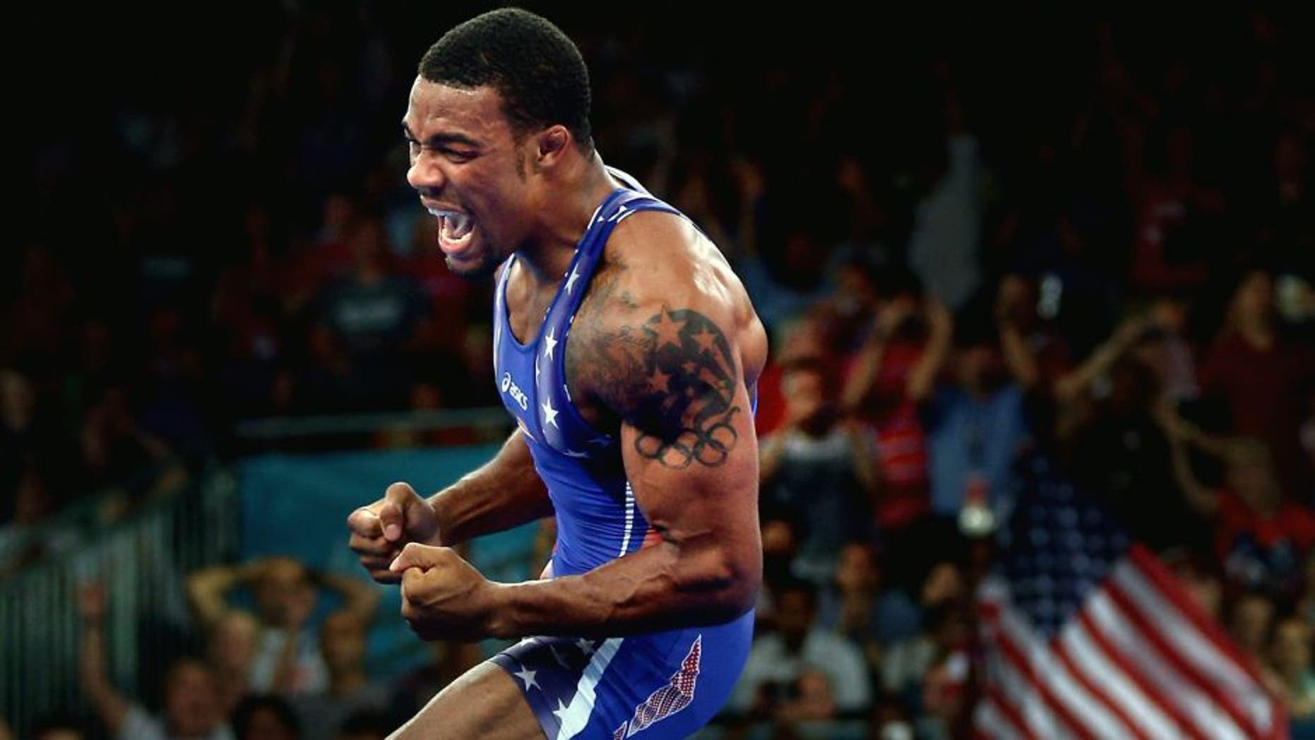 LONDON, ENGLAND - AUGUST 10: Jordan Ernest Burroughs of the United States celebrates his gold medal in the Men's Freestyle 74 kg Wrestling on Day 14 of the London 2012 Olympic Games at ExCeL on August 10, 2012 in London, England. (Photo by Feng Li/Getty Images)