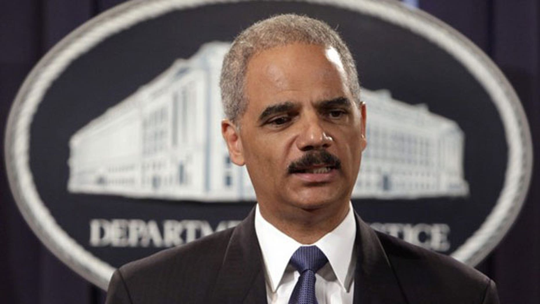 August 3: U.S. Attorney General Eric Holder holds a news conference in Washington