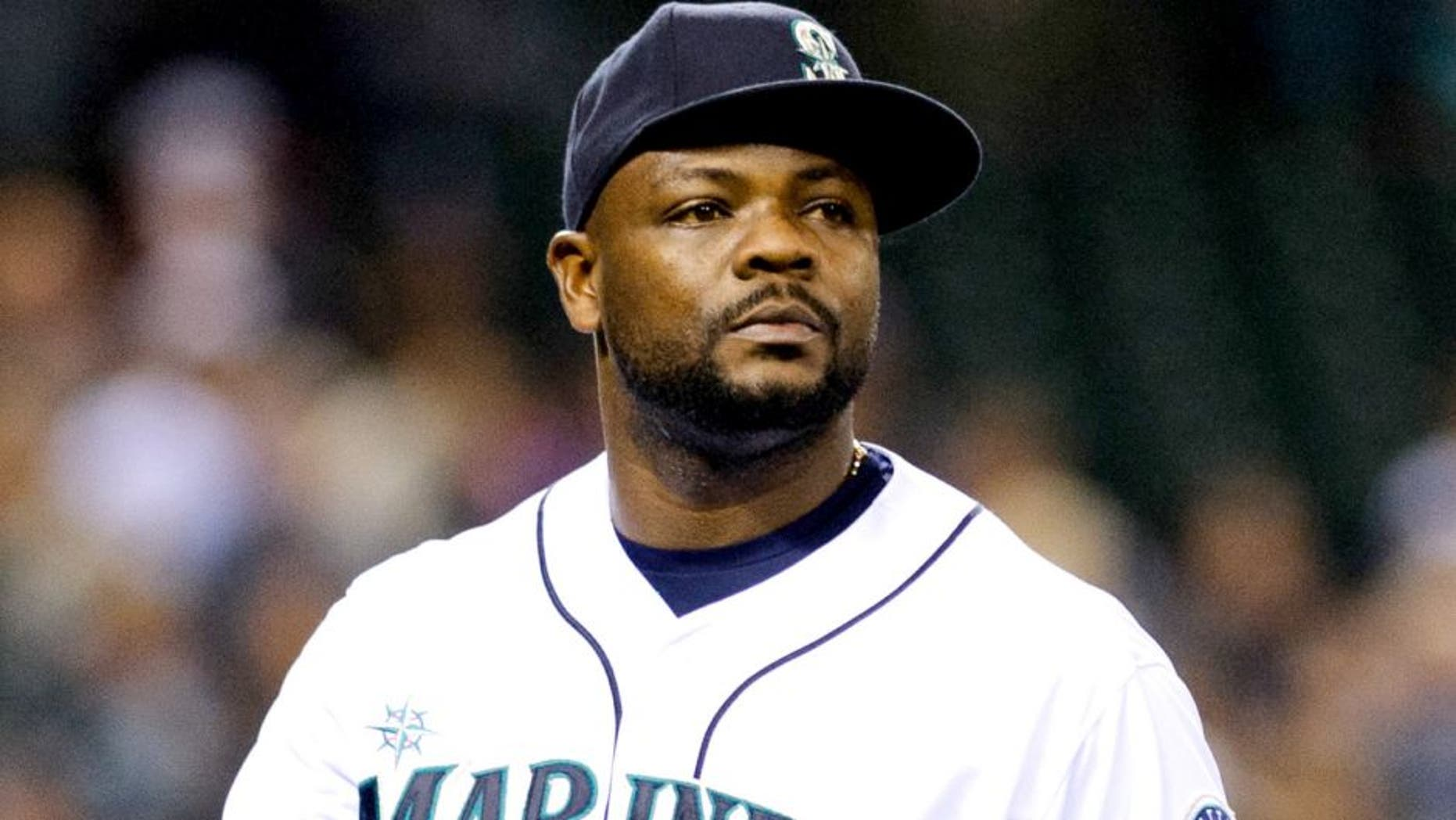Jun 14, 2014; Seattle, WA, USA; Seattle Mariners relief pitcher Fernando Rodney (56) during the game against the Texas Rangers at Safeco Field. Texas defeated Seattle 4-3. Mandatory Credit: Steven Bisig-USA TODAY Sports