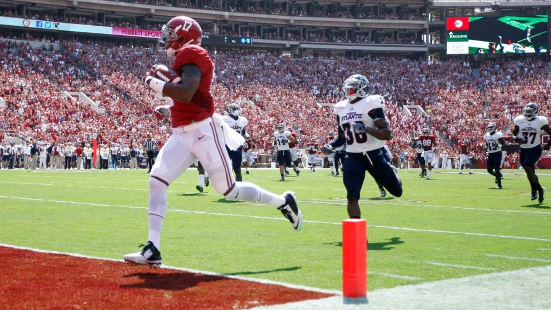 Sep 6, 2014; Tuscaloosa, AL, USA; Alabama Crimson Tide running back Kenyan Drake (17) scores against the Florida Atlantic Owls at Bryant-Denny Stadium. Mandatory Credit: Marvin Gentry-USA TODAY Sports