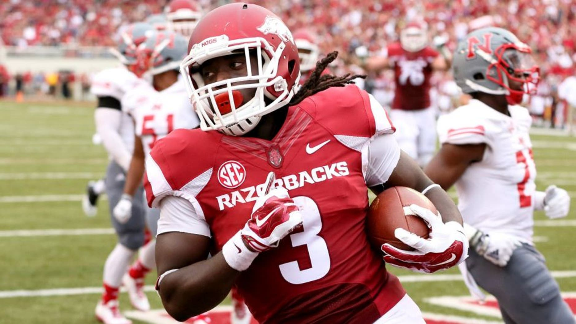 Sep 6, 2014; Fayetteville, AR, USA; Arkansas Razorbacks running back Alex Collins (3) rushes for a touchdown during the second quarter against the Nicholls State Colonels at Donald W. Reynolds Razorback Stadium. Mandatory Credit: Nelson Chenault-USA TODAY Sports
