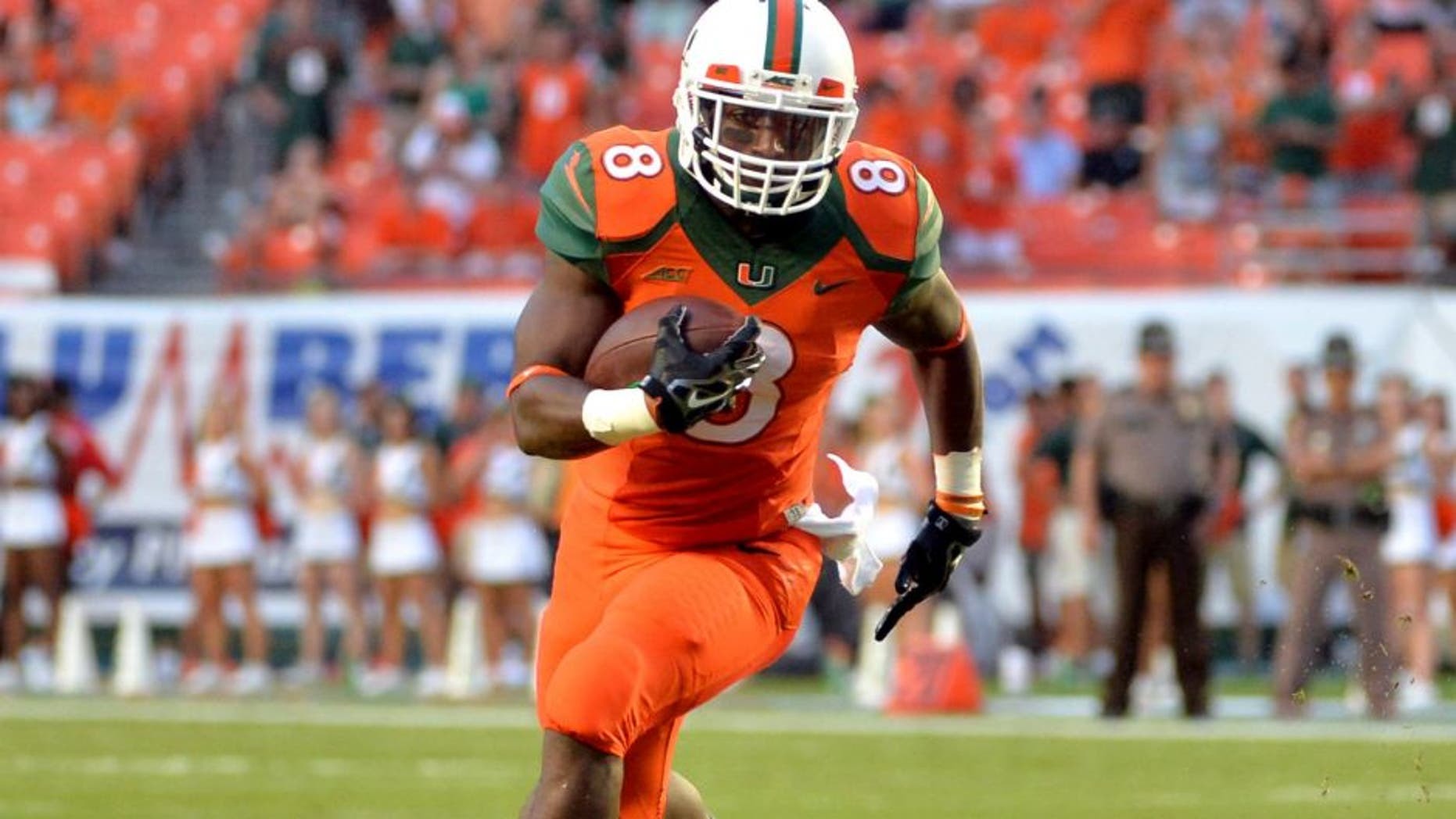 Sep 6, 2014; Miami Gardens, FL, USA; Miami Hurricanes running back Duke Johnson (8) runs against Florida A&M Rattlers defense during the first half at Sun Life Stadium. Mandatory Credit: Steve Mitchell-USA TODAY Sports