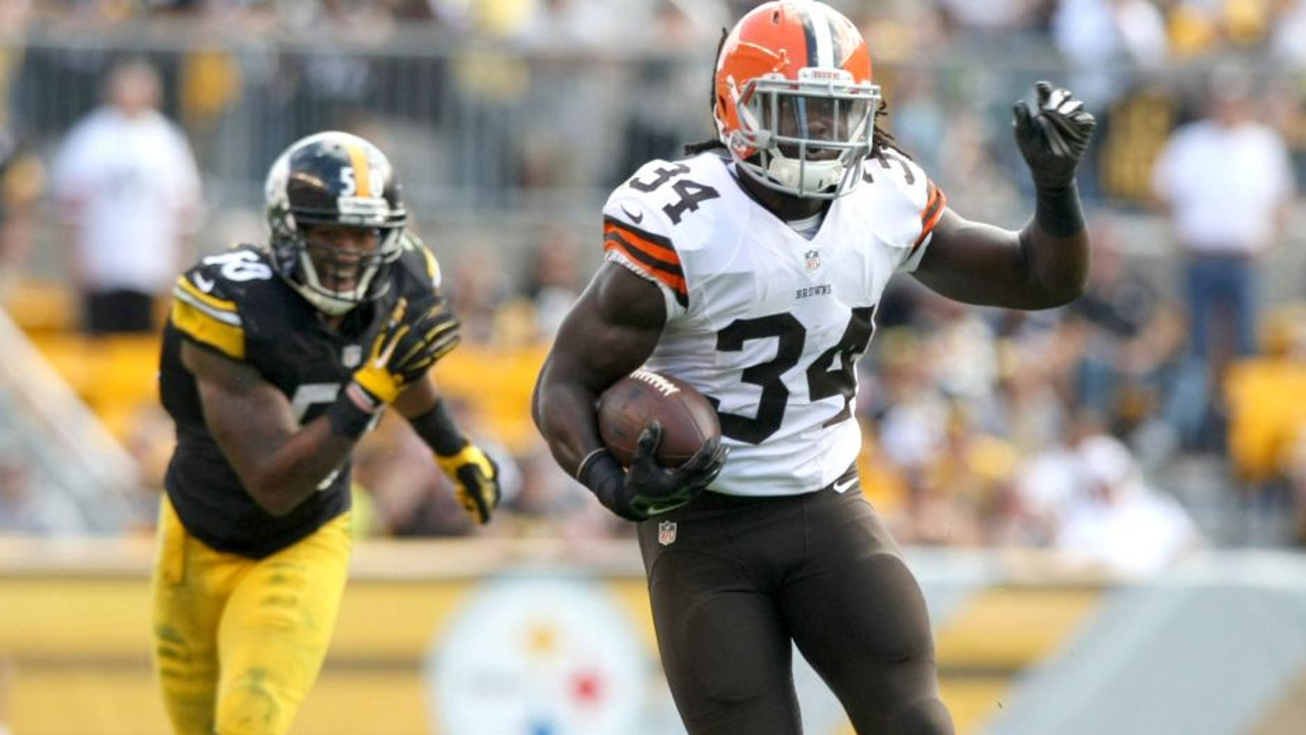 Sep 7, 2014; Pittsburgh, PA, USA; Cleveland Browns running back Isaiah Crowell (34) runs the ball past Pittsburgh Steelers linebacker Ryan Shazier (50) during the second half at Heinz Field. Pittsburgh won the game, 30-27. Mandatory Credit: Jason Bridge-USA TODAY Sports