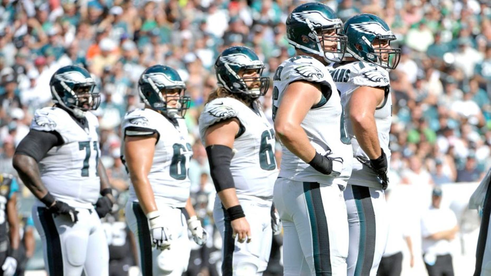 Sep 7, 2014; Philadelphia, PA, USA; Philadelphia Eagles tackle Jason Peters (71), center David Molk (63), center Jason Kelce (62), guard Todd Herremans (79) and tackle Andrew Gardner (66) during game against the Jacksonville Jaguars at Lincoln Financial Field. The Eagles defeated the Jaguars, 34-17. Mandatory Credit: Eric Hartline-USA TODAY Sports