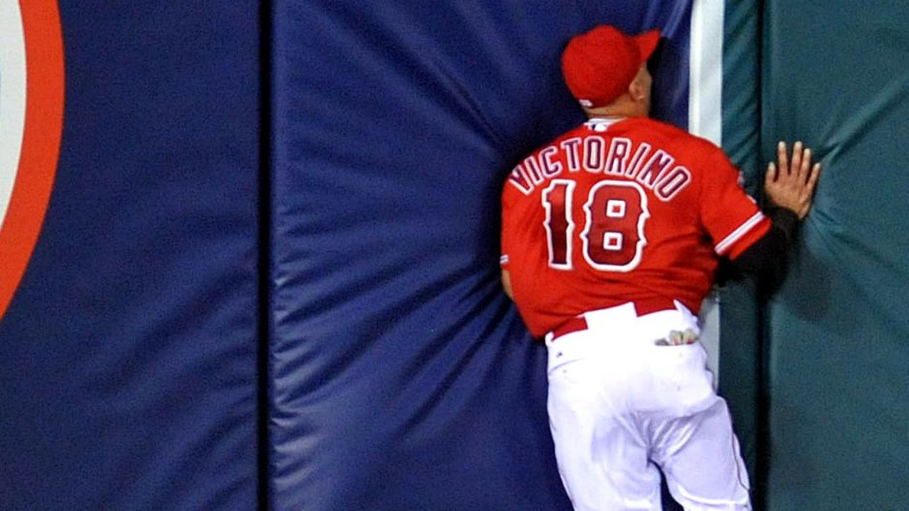 September 4, 2015; Anaheim, CA, USA; Los Angeles Angels left fielder Shane Victorino (18) runs into the wall after missing a fly ball in the seventh inning against the Texas Rangers at Angel Stadium of Anaheim. Mandatory Credit: Gary A. Vasquez-USA TODAY Sports