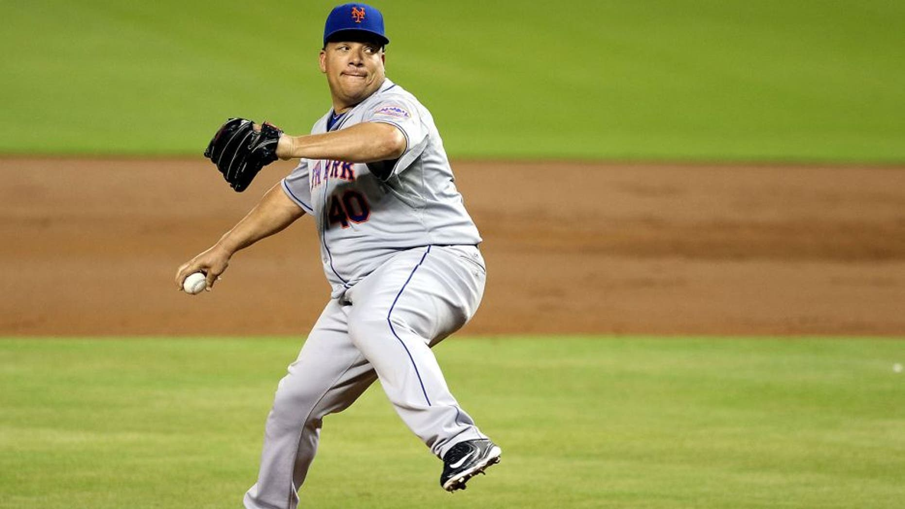 MIAMI, FL - SEPTEMBER 05: Pitcher Bartolo Colon #40 of the New York Mets throws during the first inning against the Miami Marlins at Marlins Park on September 5, 2015 in Miami, Florida. (Photo by Marc Serota/Getty Images)