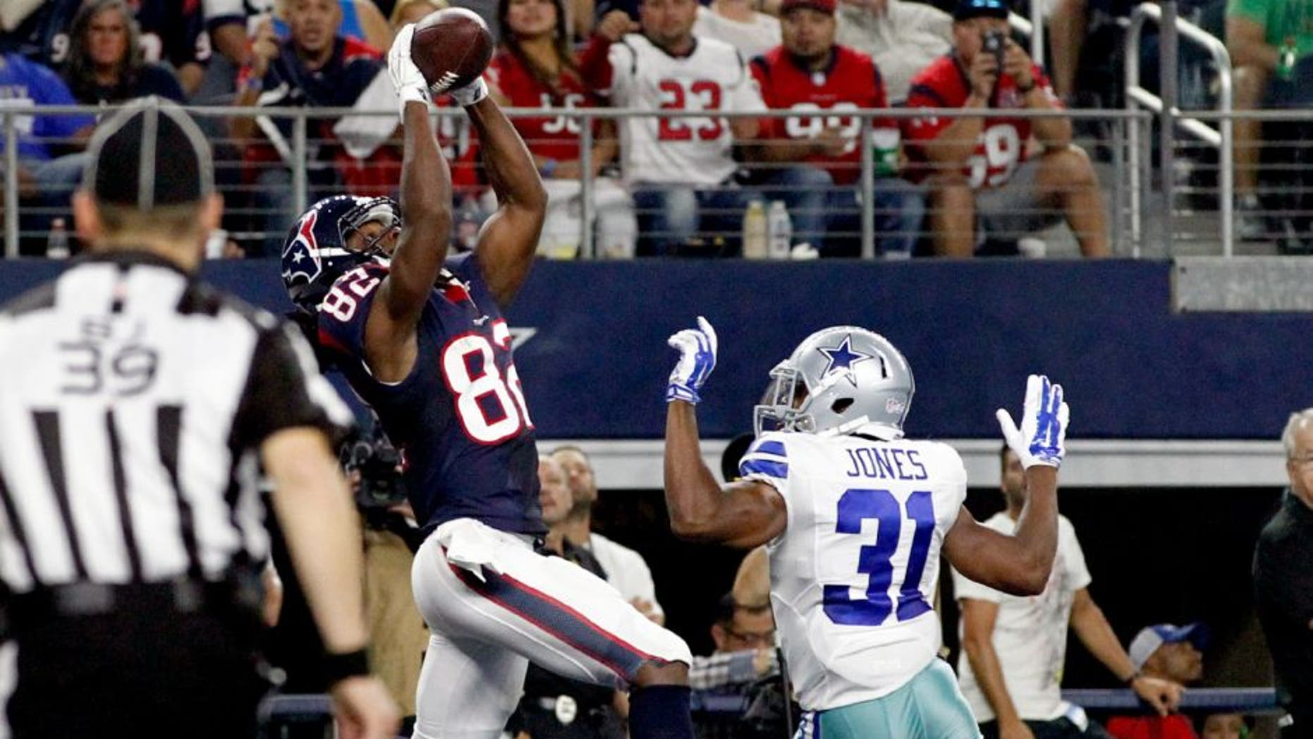 Sep 3, 2015; Arlington, TX, USA; Houston Texans wide receiver Keshawn Martin (82) catches a touchdown pass in the fourth quarter against Dallas Cowboys cornerback Byron Jones (31) at AT&T Stadium. Dallas won 21-14. Mandatory Credit: Tim Heitman-USA TODAY Sports