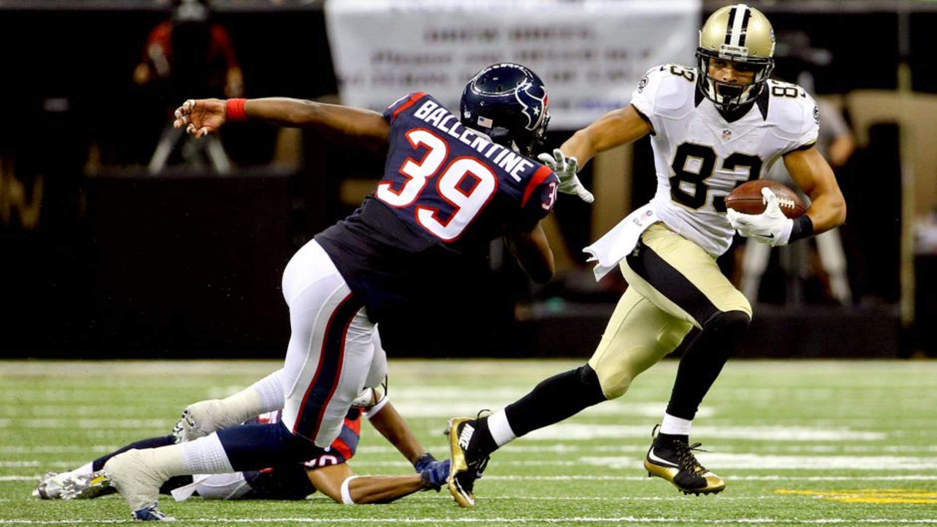 Aug 30, 2015; New Orleans, LA, USA; New Orleans Saints wide receiver Willie Snead (83) escapes from Houston Texans cornerback Kevin Johnson (30) and safety Lonnie Ballentine (39) during the first half of a preseason game at the Mercedes-Benz Superdome. Mandatory Credit: Derick E. Hingle-USA TODAY Sports