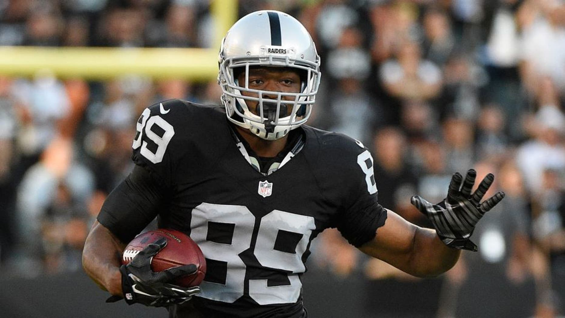 August 14, 2015; Oakland, CA, USA; Oakland Raiders wide receiver Amari Cooper (89) runs with the football against the St. Louis Rams during the first quarter in a preseason NFL football game at O.co Coliseum. Mandatory Credit: Kyle Terada-USA TODAY Sports