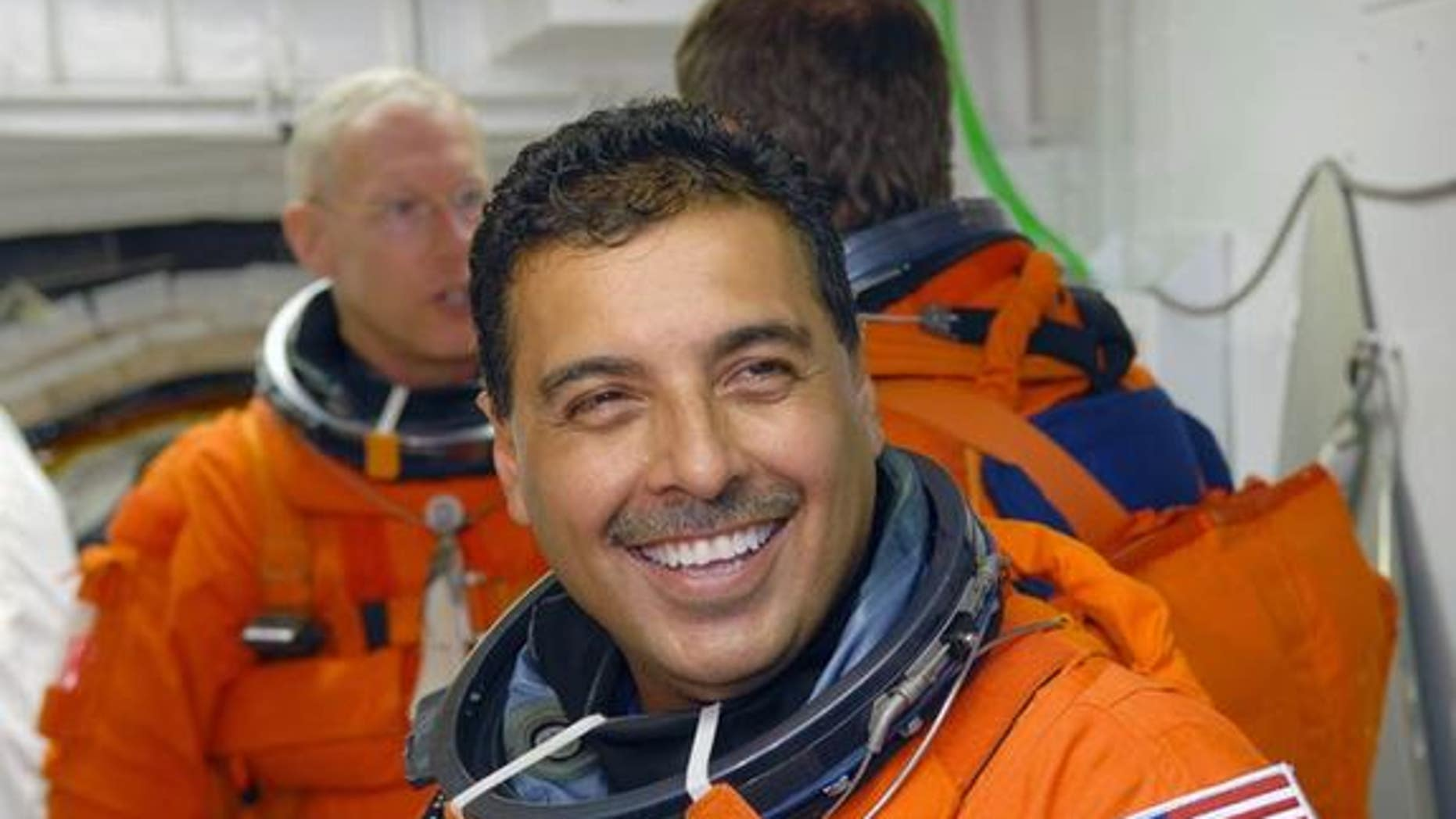 In the White Room on NASA Kennedy Space Center's Launch Pad 39A, STS-128 Mission Specialist Jose Hernandez - a former migrant farmer from Stockton, Calif. - waits his turn to enter space shuttle Discovery during a launch rehearsal for his Aug.