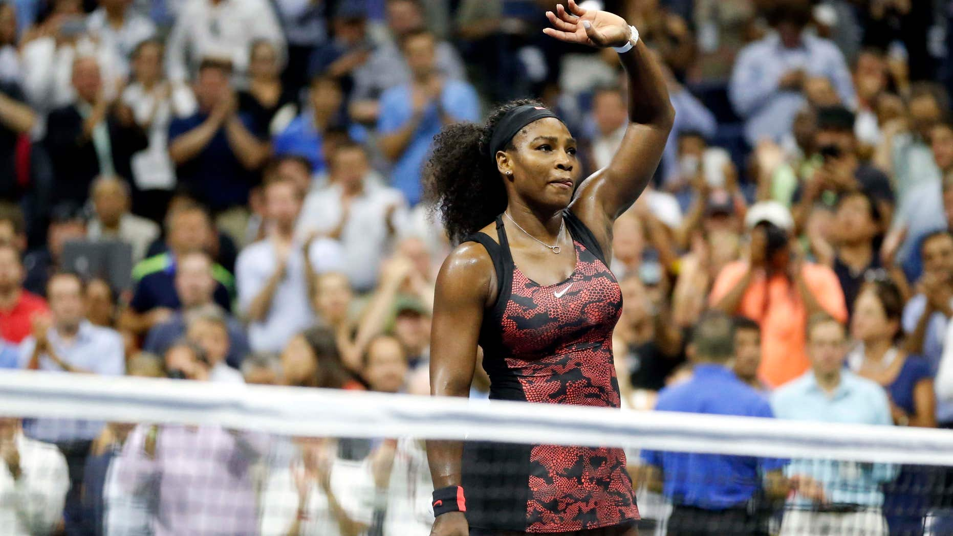 Sept. 8, 2015: Serena Williams waves to the crowd after beating Venus Williams during a quarterfinal match at the U.S. Open tennis tournament in New York.