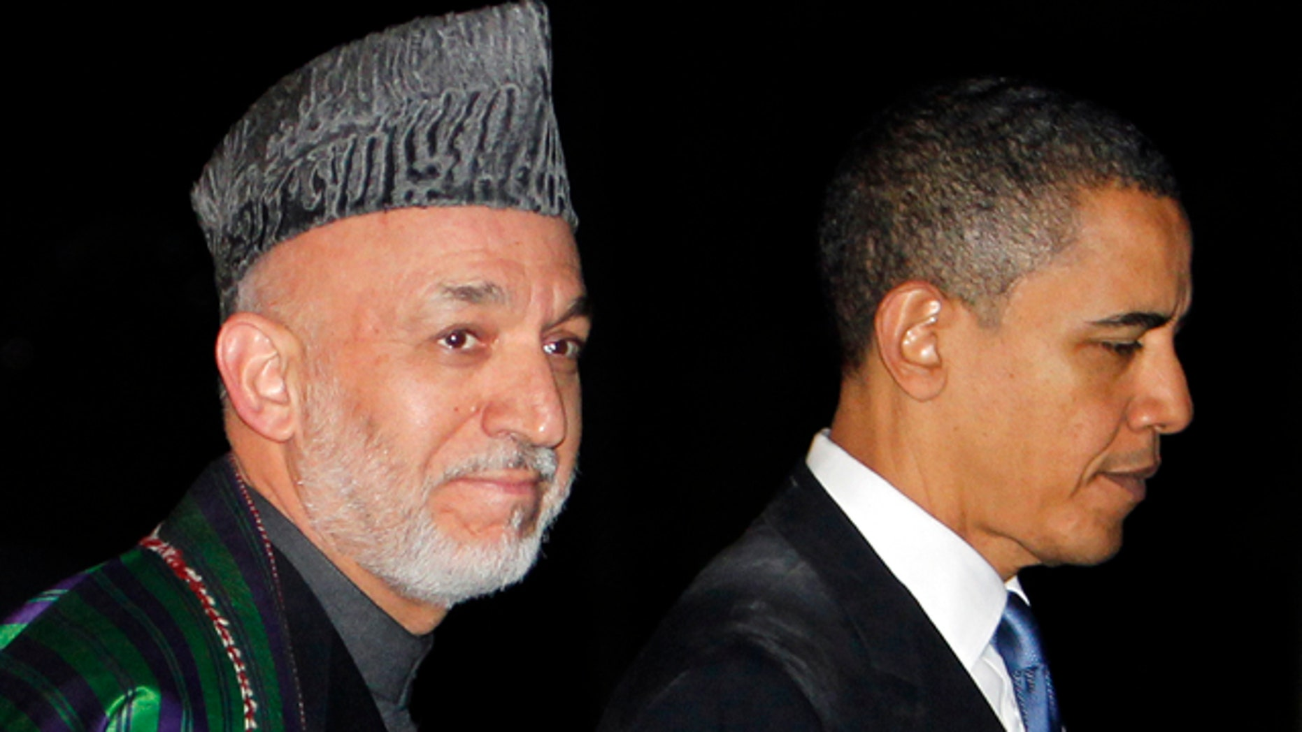 March 28: President Obama walks with Afghan President Hamid Karzai at the presidential palace in Kabul, Afghanistan.