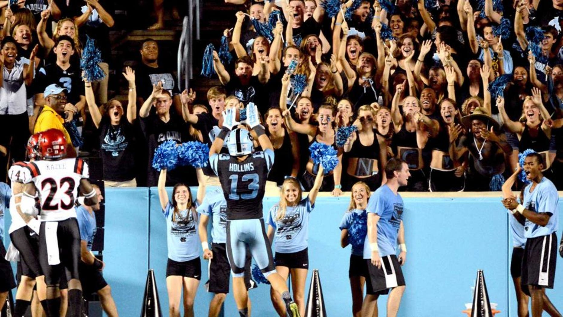 Sep 6, 2014; Chapel Hill, NC, USA;North Carolina Tar Heels receiver Mack Hollins (13) celebrates a touchdown with fans during the second half against the San Diego State Aztecs at Kenan Memorial Stadium. North Carolina won 31-27. Mandatory Credit: Rob Kinnan-USA TODAY Sports