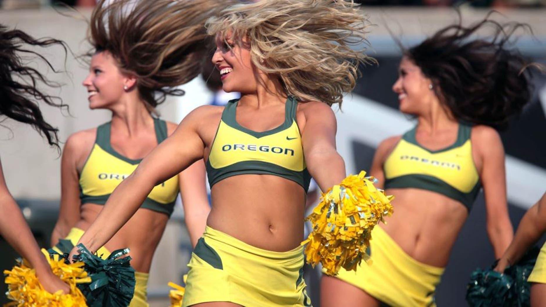 Sep 6, 2014; Eugene, OR, USA; Oregon Ducks cheerleaders preform against the Michigan State Spartans at Autzen Stadium. Mandatory Credit: Scott Olmos-USA TODAY Sports