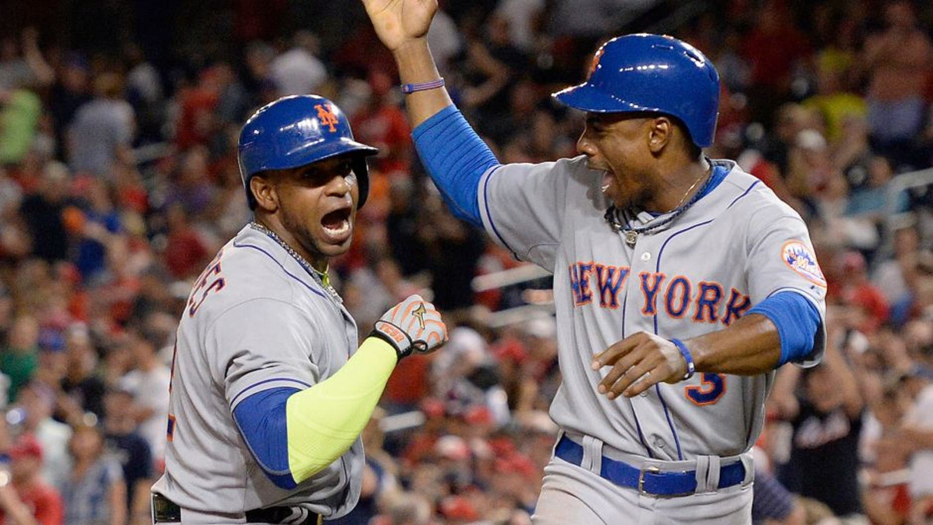 Sep 9, 2015; Washington, DC, USA; New York Mets center fielder Yoenis Cespedes (52) celebrates with right fielder Curtis Granderson (3) after hitting a two run home run in the eighth inning against the Washington Nationals at Nationals Park. New York Mets defeated Washington Nationals 5-3. Mandatory Credit: Tommy Gilligan-USA TODAY Sports