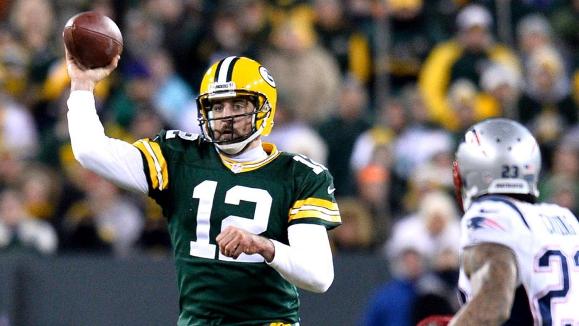 GREEN BAY, WI - NOVEMBER 30: Aaron Rodgers #12 of the Green Bay Packers throws a pass against the New England Patriots during the second quarter at Lambeau Field on November 30, 2014 in Green Bay, Wisconsin. The Packers defeated the Patriots 26-21. (Photo by Brian D. Kersey/Getty Images)