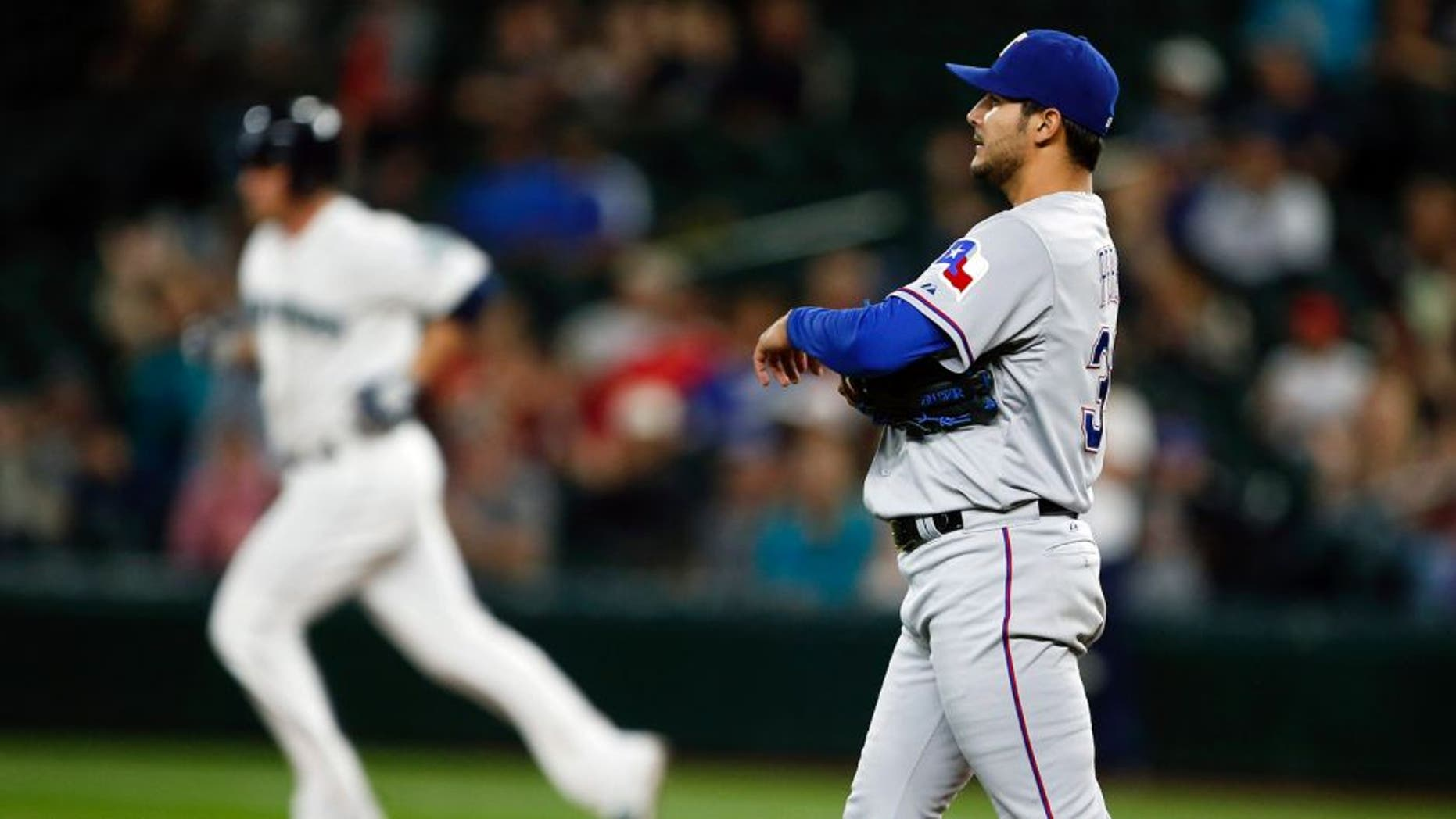 Sep 9, 2015; Seattle, WA, USA; Texas Rangers pitcher Martin Perez (33) walks around the mound after surrendering a two-run home run against the Seattle Mariners during the third inning at Safeco Field. Mandatory Credit: Joe Nicholson-USA TODAY Sports