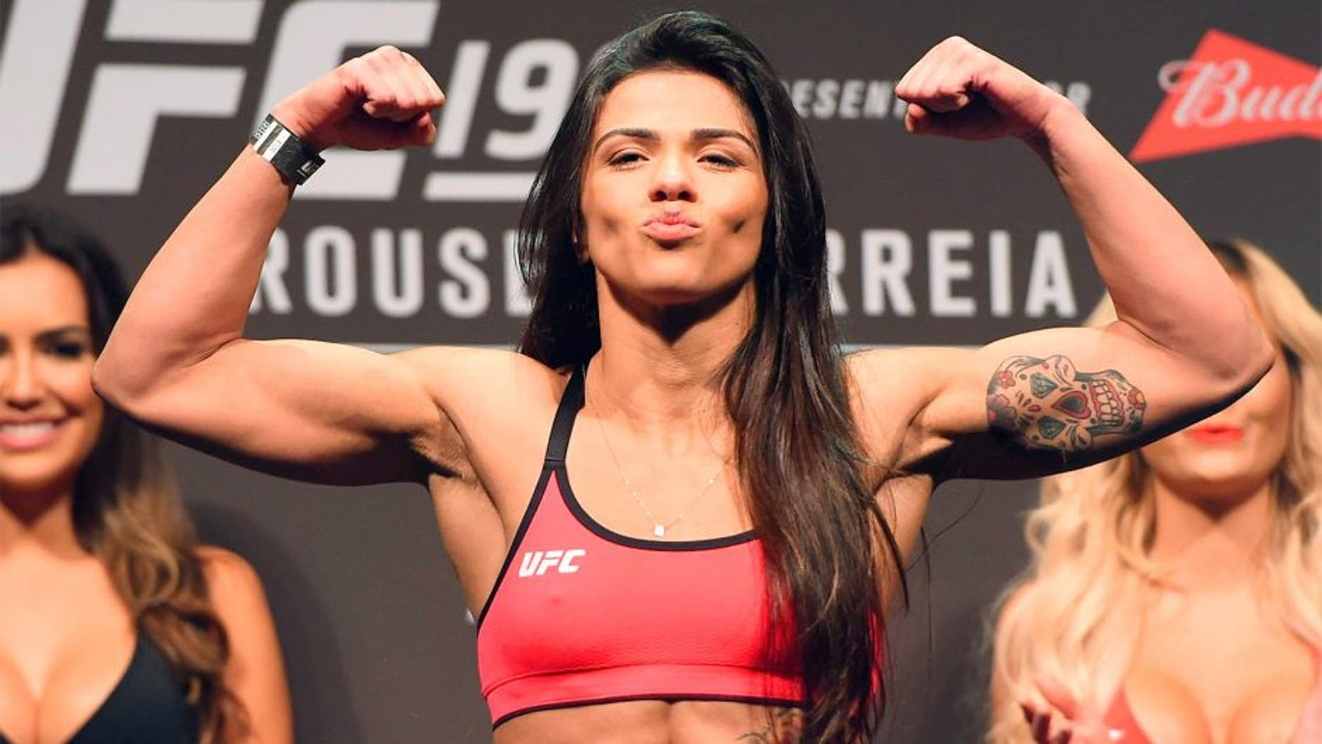 RIO DE JANEIRO, BRAZIL - JULY 31: Claudia Gadelha steps onto the scale during the UFC 190 weigh-in inside HSBC Arena on July 31, 2015 in Rio de Janeiro, Brazil. (Photo by Josh Hedges/Zuffa LLC/Zuffa LLC via Getty Images)