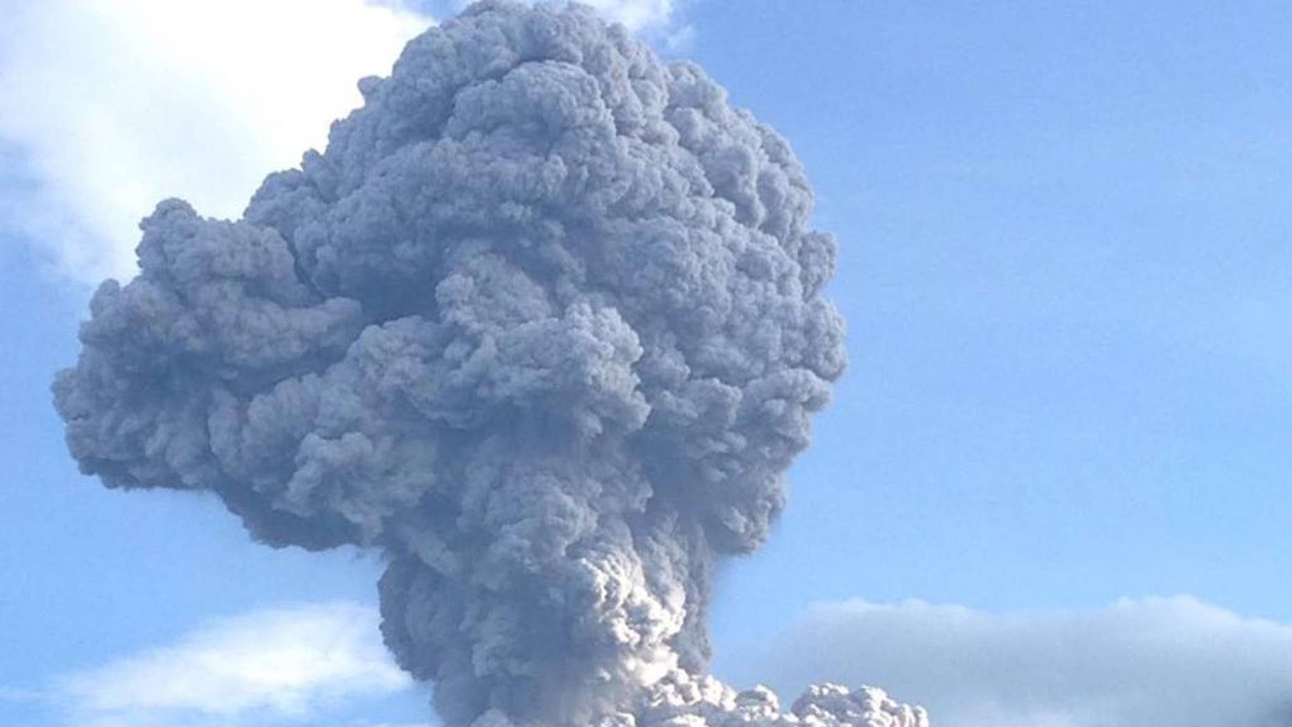 In this photo released by Guatemala's National Seismological Institute, the Santiaguito volcano blows outs a thick cloud of ash in Quetzaltenango, Guatemala, Tuesday, Aug. 16, 2016. Disaster response agency spokesman David De Leon said the ash fell as far away as Mexico's southern state of Chiapas. De Leon said the volcano is one of the most explosive in Latin America, with about 76 eruptions this year. (Guatemala's National Seismological Institute via AP)