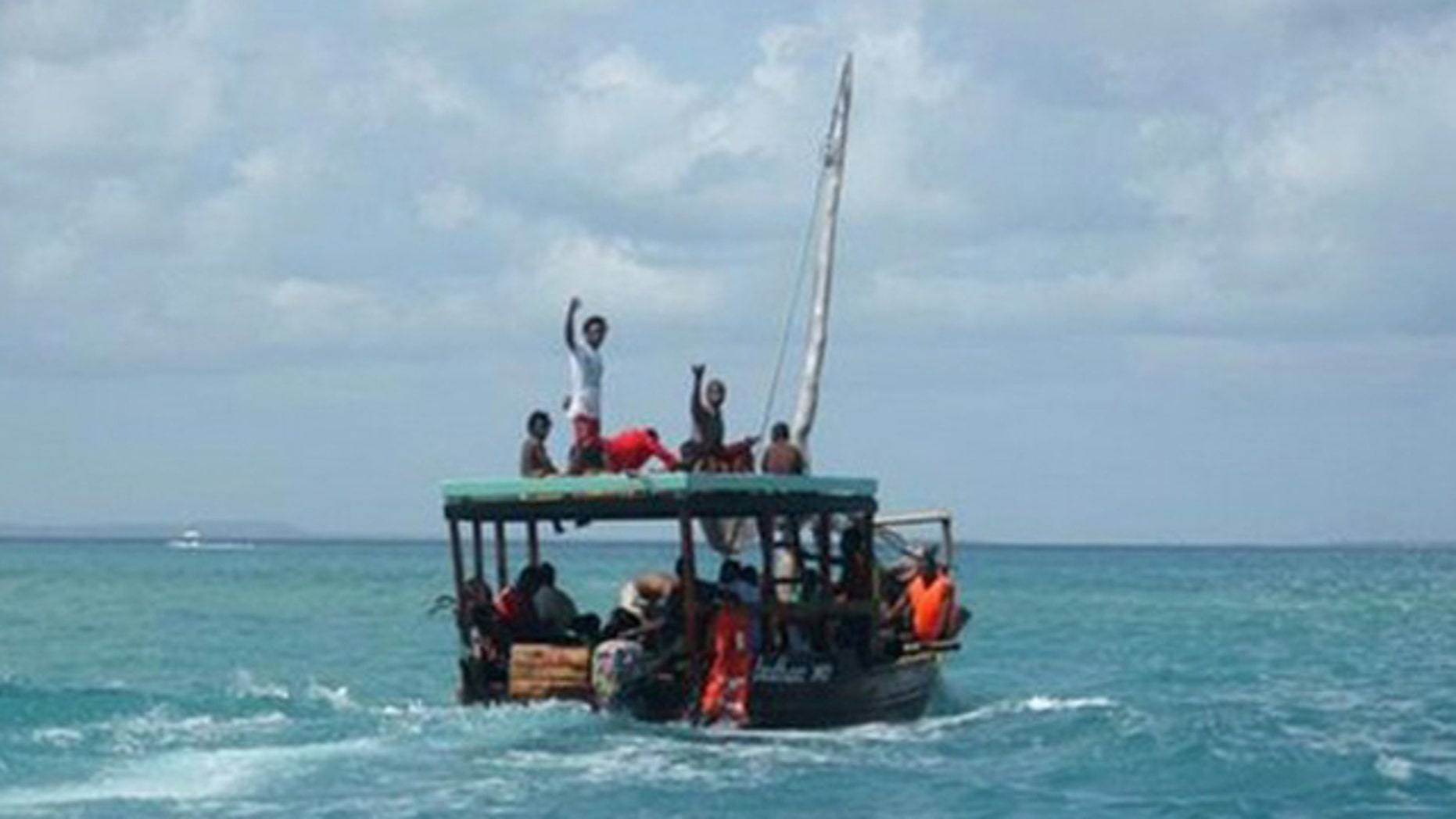 Sept. 10: A Zanzibar fishing vessel carries the survivors of the ferry crash ashore.