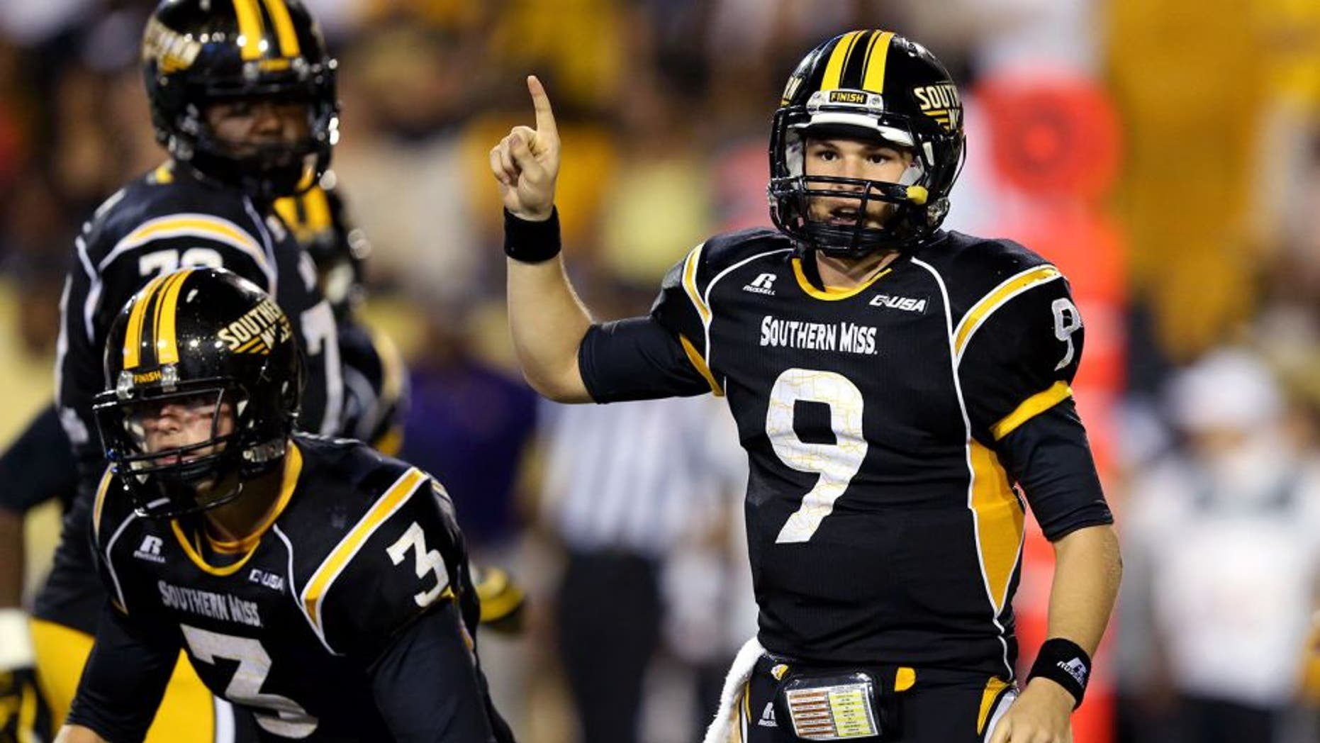 Sep 6, 2014; Hattiesburg, MS, USA; Southern Miss Golden Eagles quarterback Nick Mullens (9) gestures during the second half of their game against the Alcorn State Braves at M.M. Roberts Stadium. Mandatory Credit: Chuck Cook-USA TODAY Sports