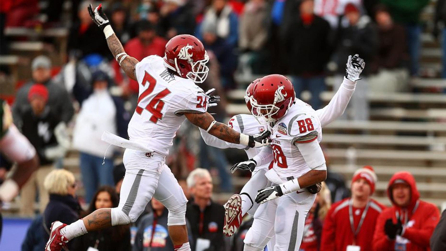 Dec 21, 2013; Albuquerque, NM, USA; Washington State Cougars wide receiver Isiah Myers (88) is congratulated by teammate Theron West (24) after a second half touchdown against the Colorado State Rams during the Gildan New Mexico Bowl at University Stadium. The Rams defeated the Cougars 48-45. Mandatory Credit: Mark J. Rebilas-USA TODAY Sports