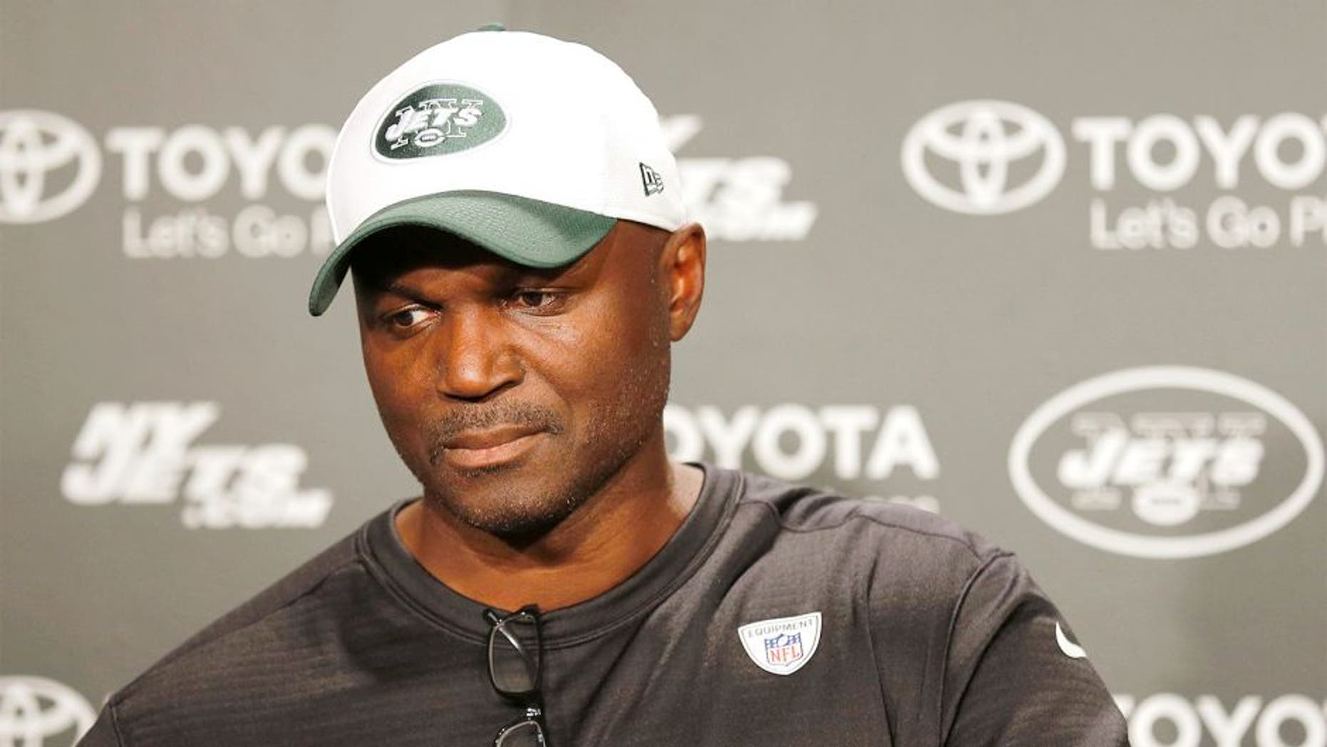 August 11, 2015; Florham Park, NJ, USA; New York Jets head coach Todd Bowles answers questions about Geno Smith (not pictured) after the New York Jets hold practice at the Atlantic Health Jets Training Center. Mandatory Credit: John Munson/THE STAR-LEDGER via USA TODAY Sports