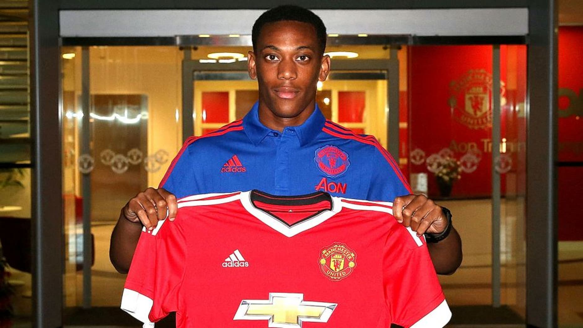 MANCHESTER, ENGLAND - SEPTEMBER 01: (EXCLUSIVE COVERAGE) (MINIMUM FEES APPLY - 150 GBP PRINT AND ON AIR & 75 GBP ONLINE OR LOCAL EQUIVALENT, PER IMAGE) Manchester United unveil new signing Anthony Martial at Aon Training Complex on September 1, 2015 in Manchester, England. (Photo by John Peters/Man Utd via Getty Images)