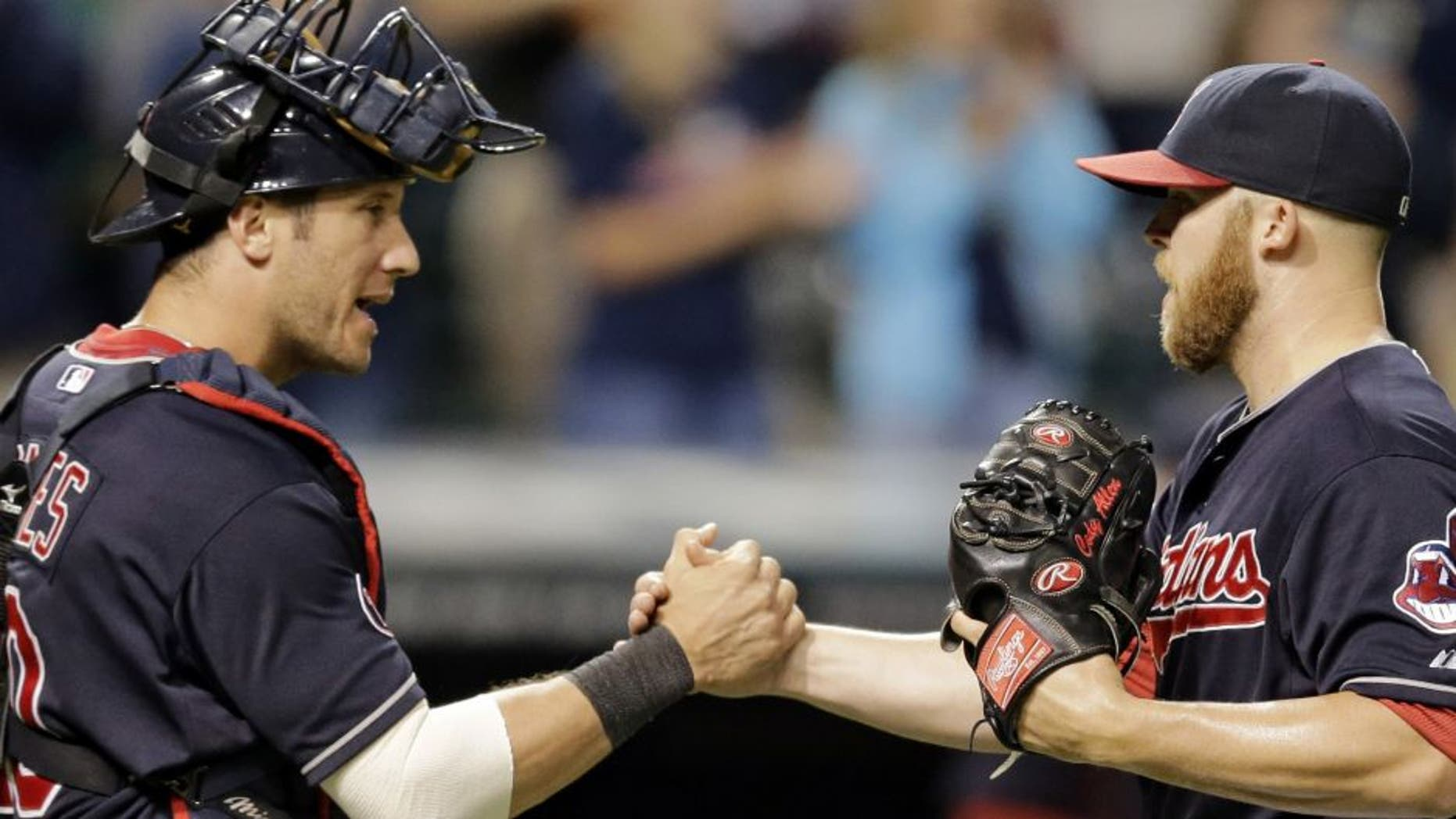 Cleveland Indians catcher Yan Gomes, left, congratulates relief pitcher Cody Allen after they defeated the Detroit Tigers 7-5 on Thursday night