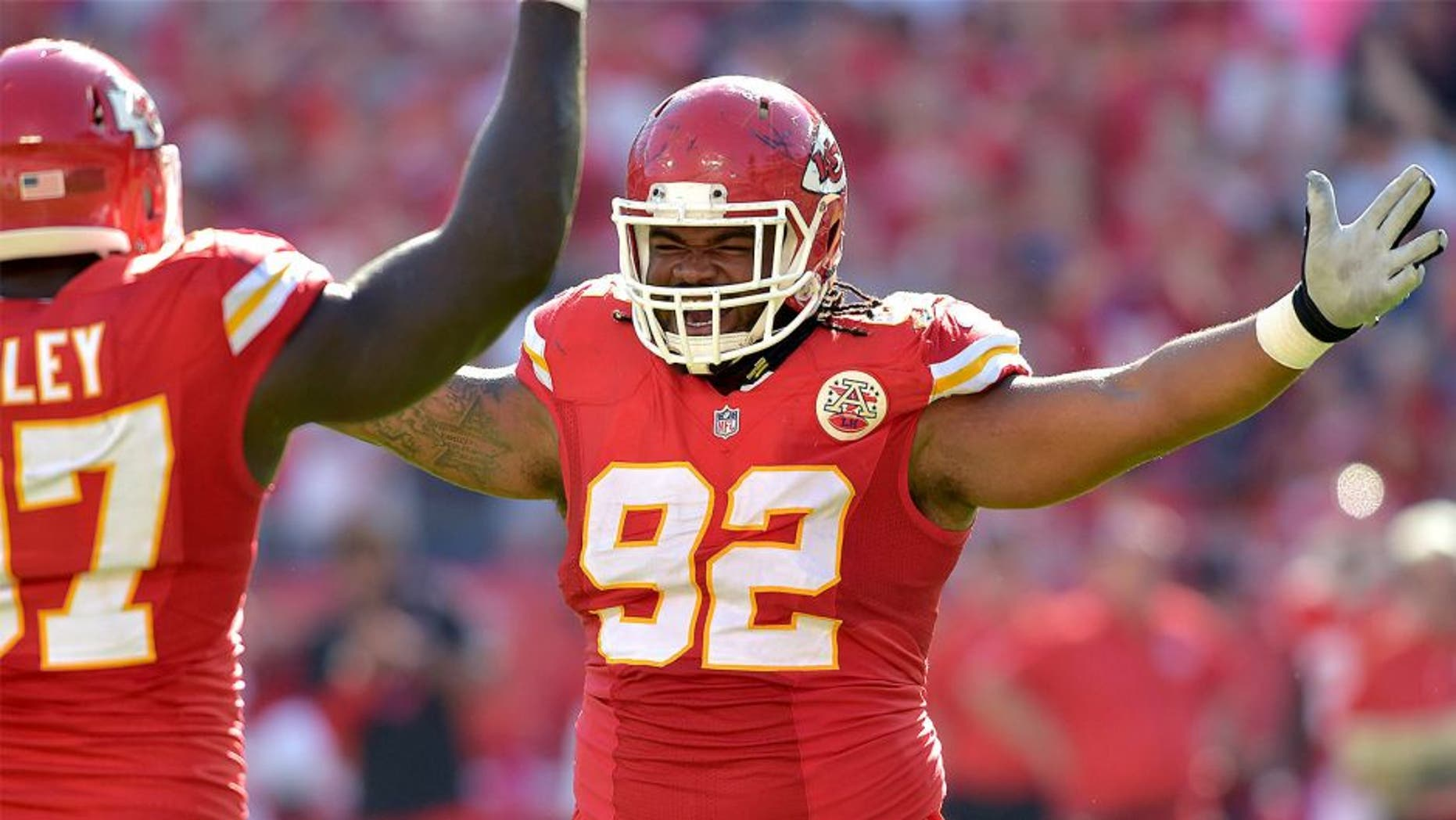 Oct 26, 2014; Kansas City, MO, USA; Kansas City Chiefs nose tackle Dontari Poe (92) congratulates defensive end Allen Bailey (97) after Bailey's sack of St. Louis Rams quarterback Austin Davis (9) (not pictured) during the second half at Arrowhead Stadium. The Chiefs won 34-7. Mandatory Credit: Denny Medley-USA TODAY Sports