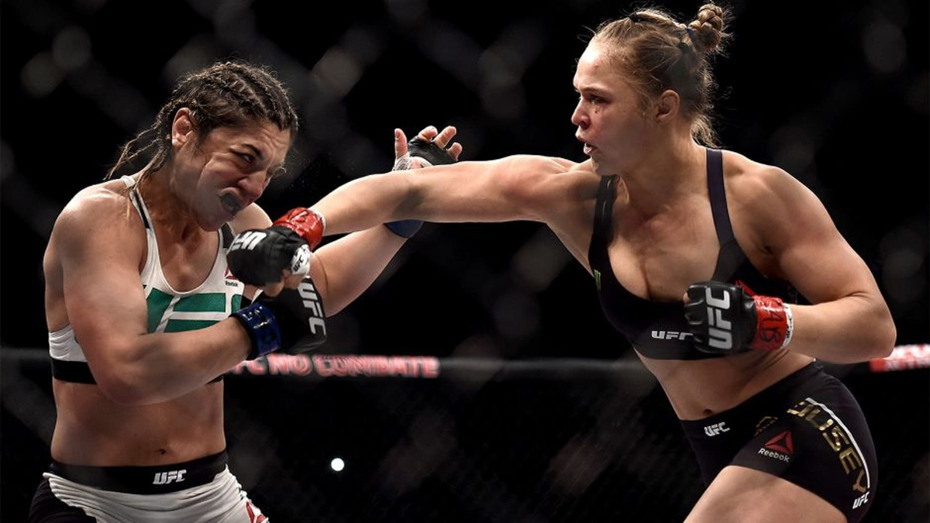 RIO DE JANEIRO, BRAZIL - AUGUST 01: Ronda Rousey of the United States punches Bethe Correia of Brazil in their bantamweight title fight during the UFC 190 Rousey v Correia at HSBC Arena on August 1, 2015 in Rio de Janeiro, Brazil. (Photo by Buda Mendes/Zuffa LLC/Zuffa LLC via Getty Images)