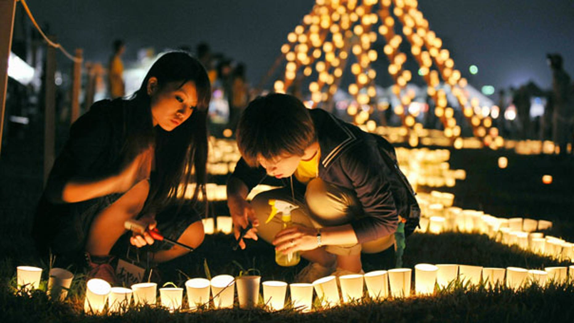 Sept. 11: Local residents light a candle at a park during a memorial event marking six months after the March 11 earthquake and tsunami in Iwanuma city, Miyagi prefecture.