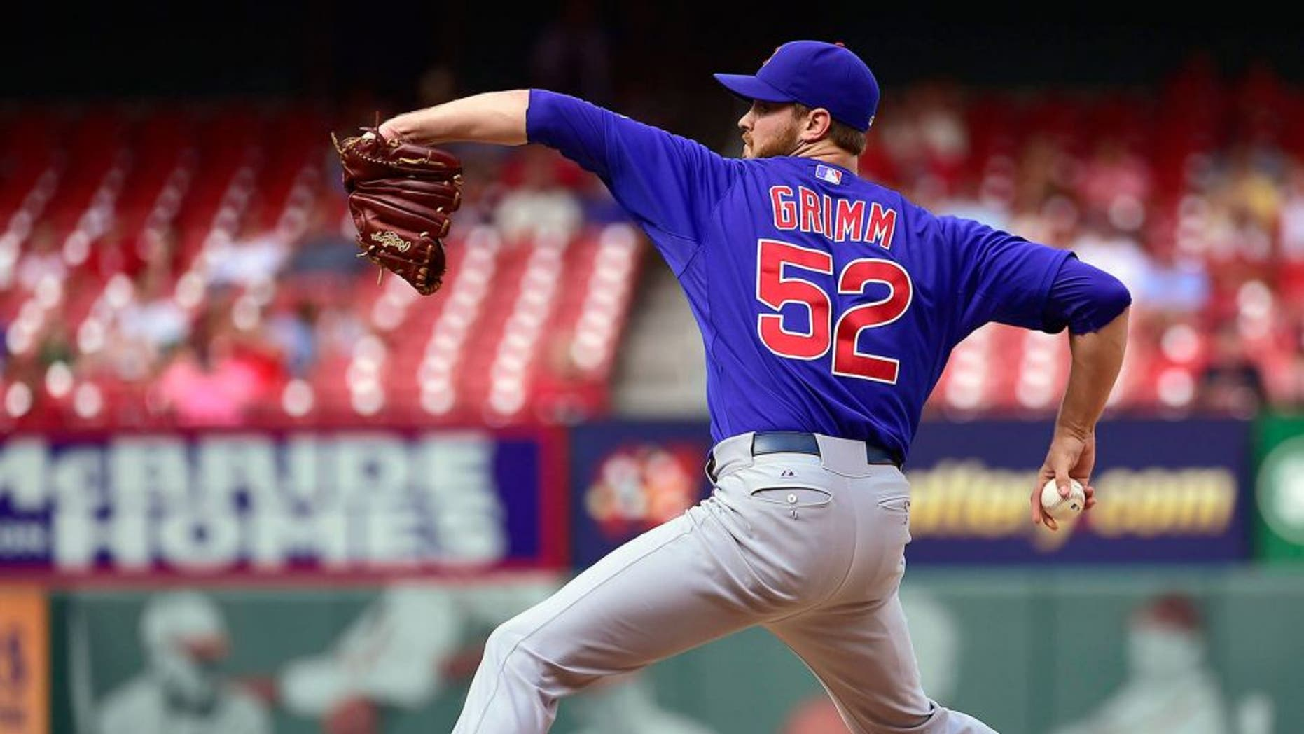 Aug 30, 2014; St. Louis, MO, USA; Chicago Cubs relief pitcher Justin Grimm (52) delivers a pitch against the St. Louis Cardinals during the ninth inning at Busch Stadium. The Cubs defeated the Cardinals 5-1. Mandatory Credit: Scott Rovak-USA TODAY Sports
