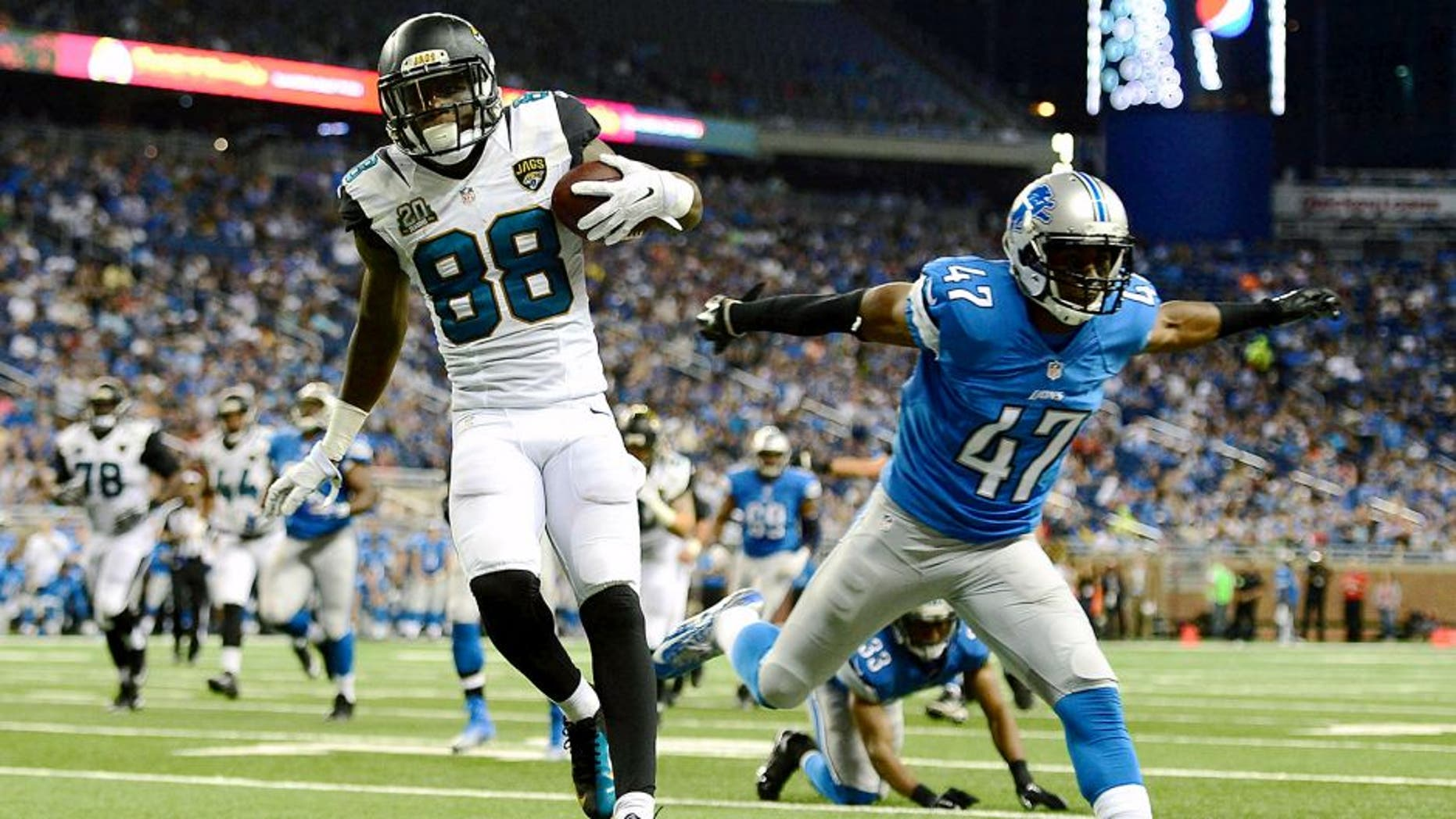 Aug 22, 2014; Detroit, MI, USA; Jacksonville Jaguars wide receiver Allen Hurns (88) gets away from Detroit Lions defensive back Nate Ness (47) to score a touchdown during the third quarter at Ford Field. Mandatory Credit: Andrew Weber-USA TODAY Sports