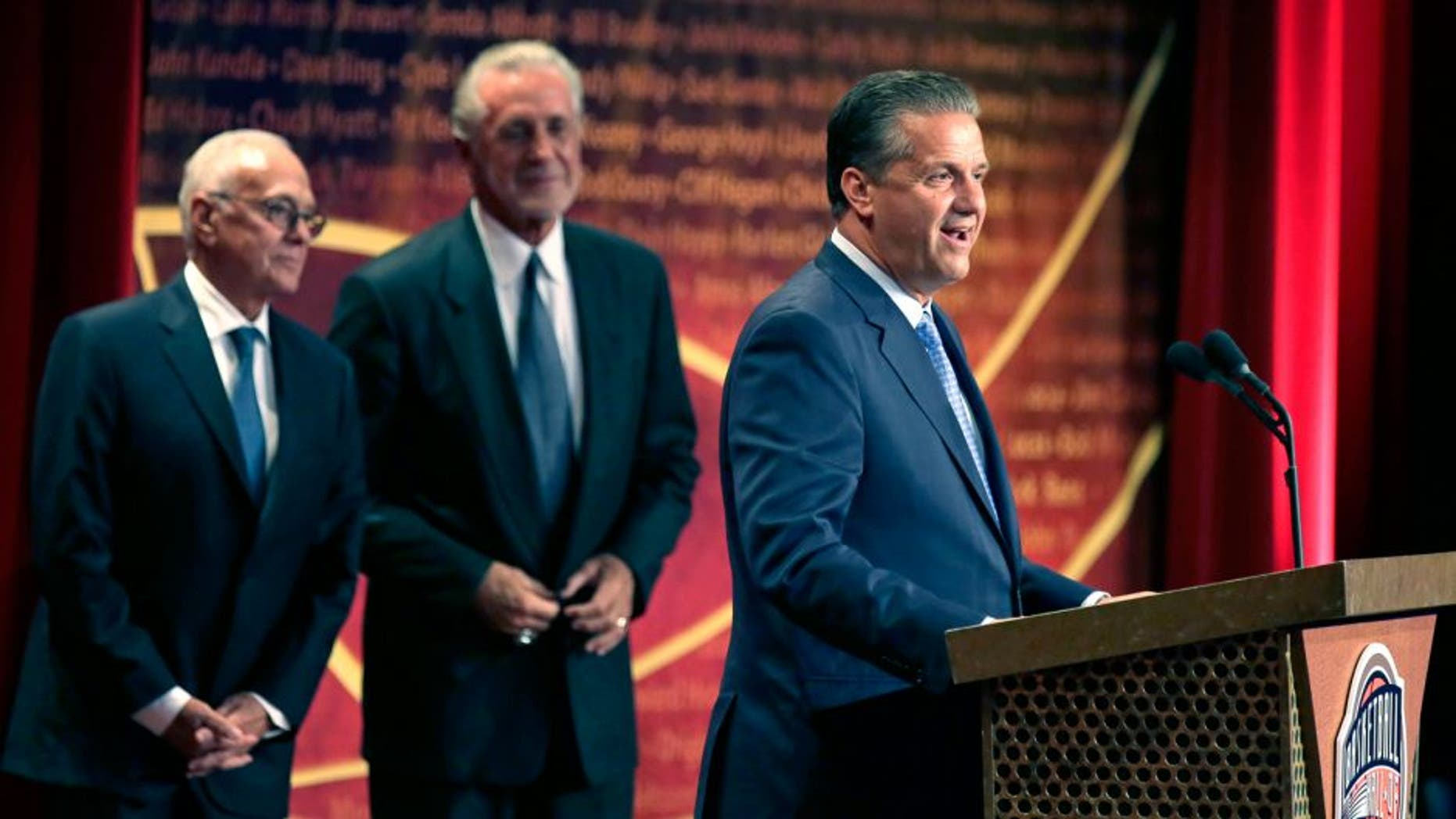 Basketball Hall of Fame inductee coach John Calipari stands with his presenters Larry Brown, left, and Pat Riley during the enshrinement ceremony for the Class of 2015 of the Naismith Memorial Basketball Hall of Fame in Springfield, Mass., Friday, Sept. 11, 2015. (AP Photo/Charles Krupa)