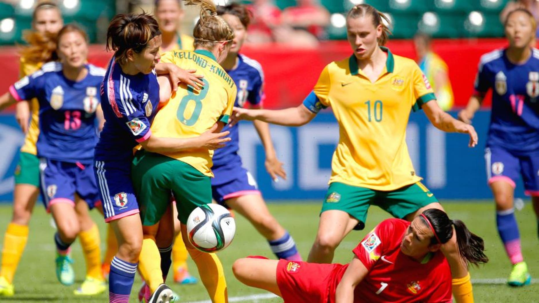EDMONTON, AB - JUNE 27: Elise Kellond-Knight #8 defends as goalkeeper Lydia Williams #1 of Australia attempts to save the ball against Azusa Iwashimizu #3 of Japan during the FIFA Women's World Cup Canada 2015 Quarter Final match between Australia and Japan at Commonwealth Stadium on June 27, 2015 in Edmonton, Canada. (Photo by Kevin C. Cox/Getty Images)