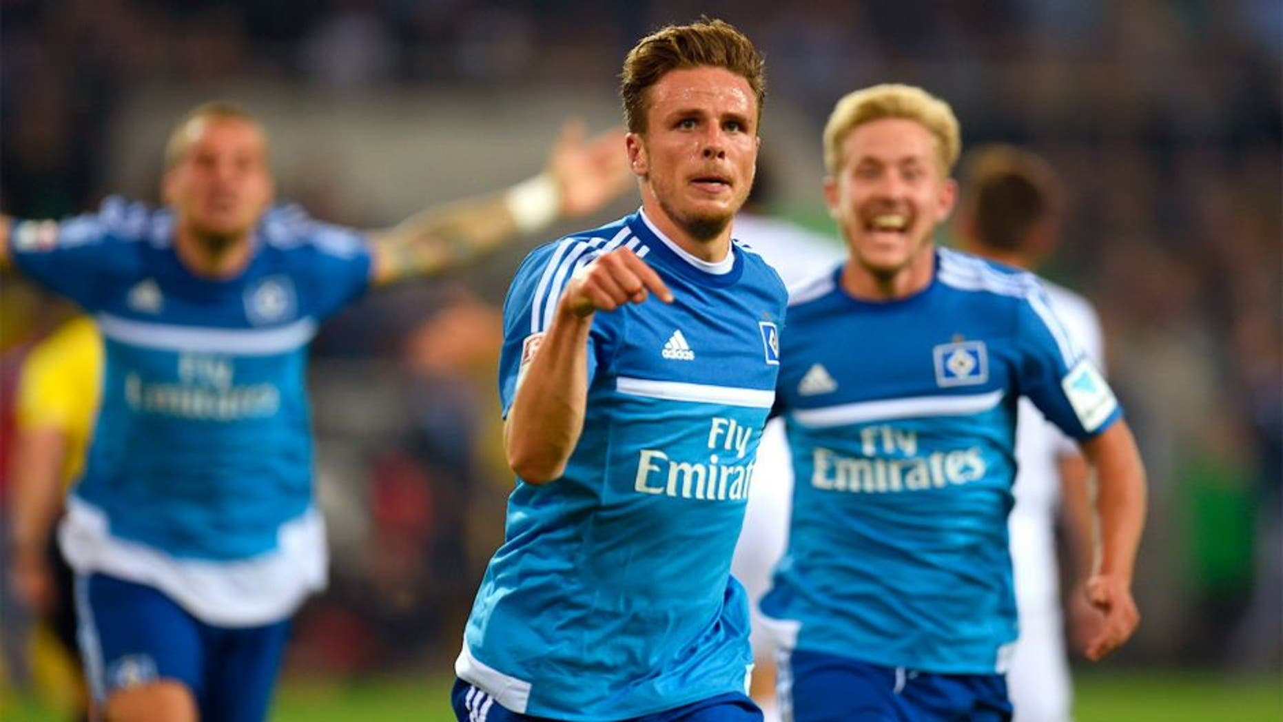 Hamburg's midfielder Nicolai Mueller celebrates after scoring during the German first division Bundesliga football match Borussia Moenchengladbach vs Hamburger SV in Moenchengladbach, western Germany, on September 11, 2015. AFP PHOTO / PATRIK STOLLARZ RESTRICTIONS: DURING MATCH TIME: DFL RULES TO LIMIT THE ONLINE USAGE TO 15 PICTURES PER MATCH AND FORBID IMAGE SEQUENCES TO SIMULATE VIDEO. == RESTRICTED TO EDITORIAL USE == FOR FURTHER QUERIES PLEASE CONTACT DFL DIRECTLY AT + 49 69 650050. (Photo credit should read PATRIK STOLLARZ/AFP/Getty Images)