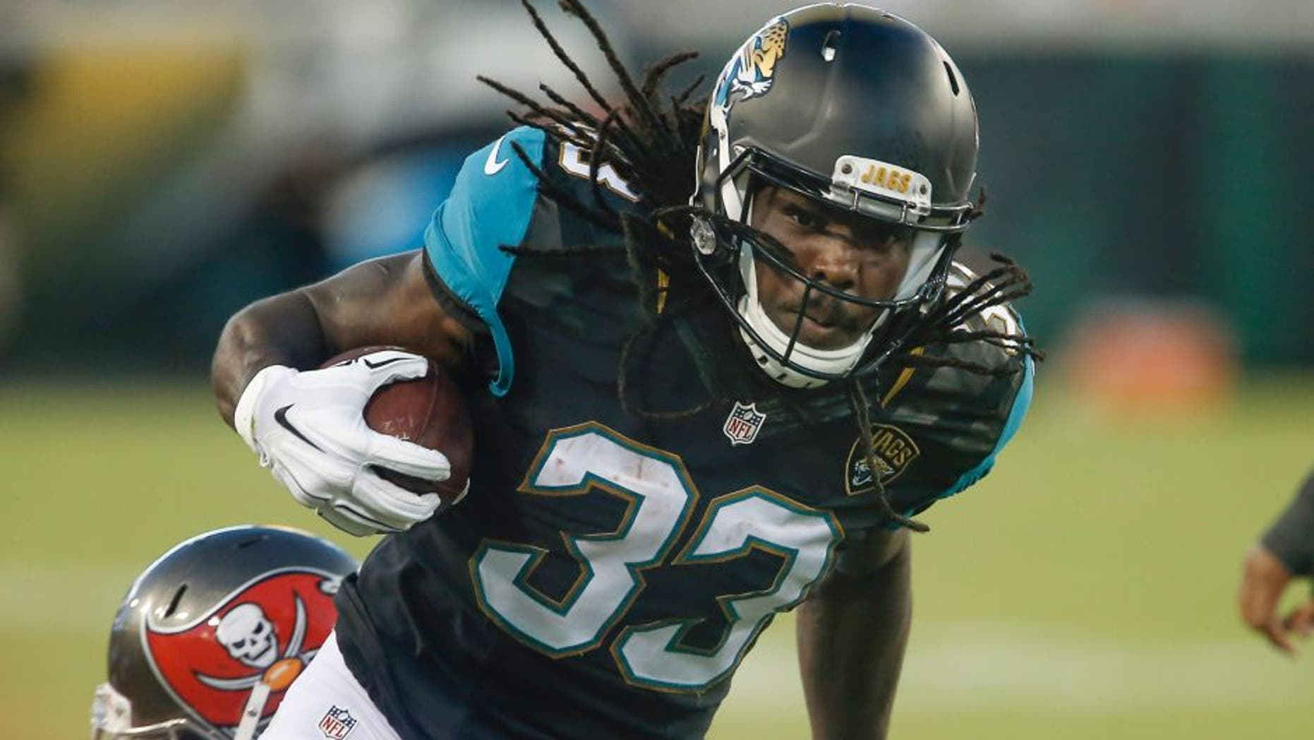 Aug 20, 2016; Jacksonville, FL, USA; Jacksonville Jaguars running back Chris Ivory (33) runs during the first quarter of a football game against the Tampa Bay Buccaneers at EverBank Field. Mandatory Credit: Reinhold Matay-USA TODAY Sports