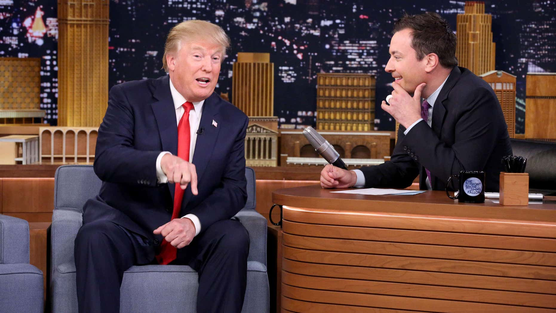 """Sept. 11, 2015: In this image released by NBC, Republican presidential candidate Donald Trump, left, appears with host Jimmy Fallon during a taping of """"The Tonight Show Starring Jimmy Fallon,"""" in New York."""