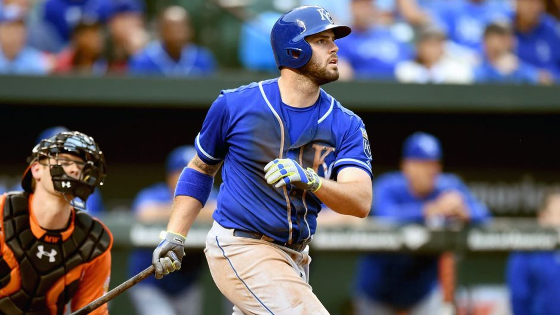 BALTIMORE, MD - SEPTEMBER 12: Mike Moustakas #8 of the Kansas City Royals hits a grand slam in the seventh inning during a baseball game against the Baltimore Orioles at Oriole Park at Camden Yards on September 12, 2015 in Baltimore, Maryland. (Photo by Mitchell Layton/Getty Images)