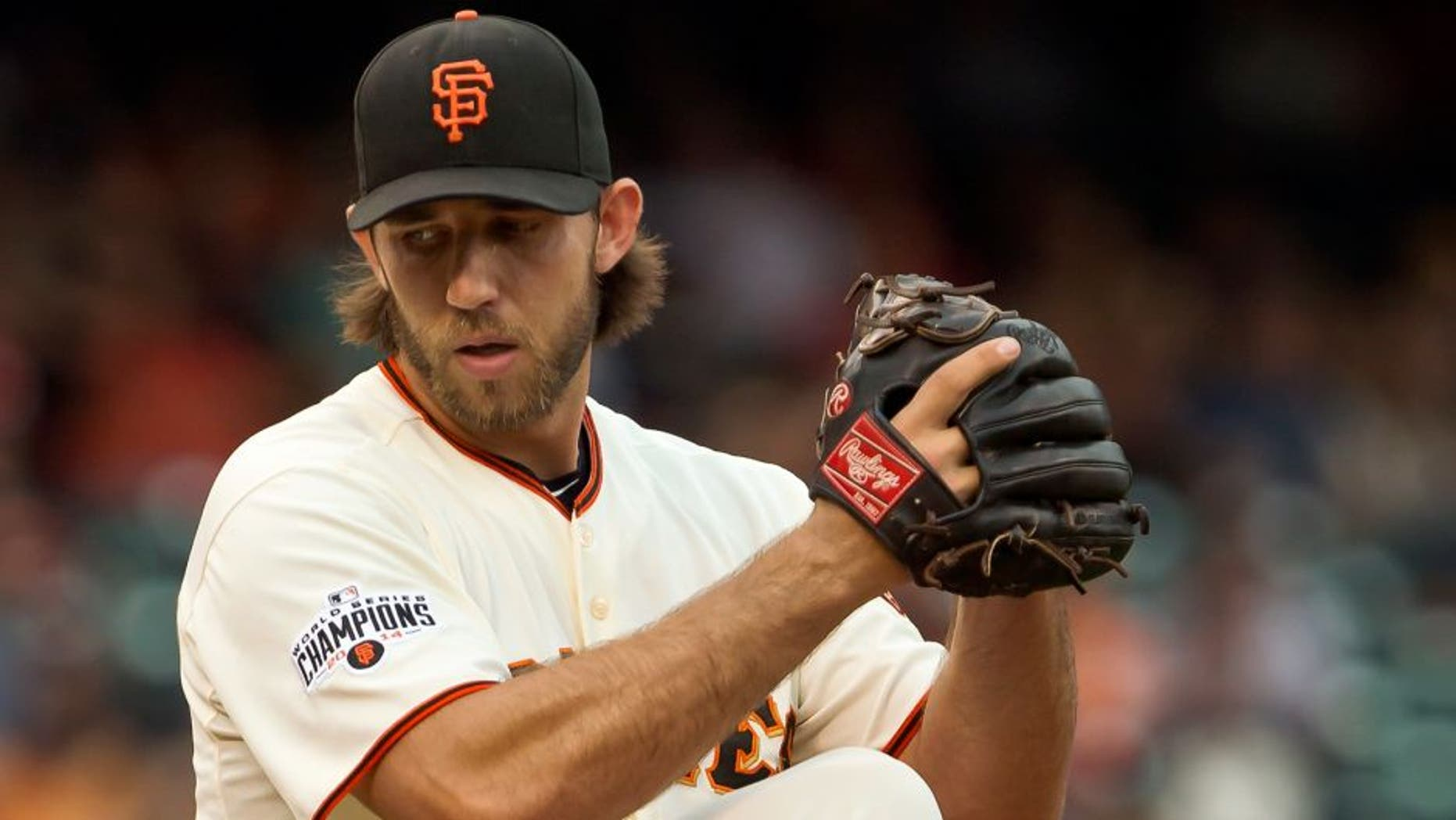 SAN FRANCISCO, CA - SEPTEMBER 12: Starting pitcher Madison Bumgarner #40 of the San Francisco Giants winds up for a pitch against the San Dieigo Padres at AT&T Park in the first inning on September 12, 2015 in San Francisco, California. (Photo by Brian Bahr/Getty Images)