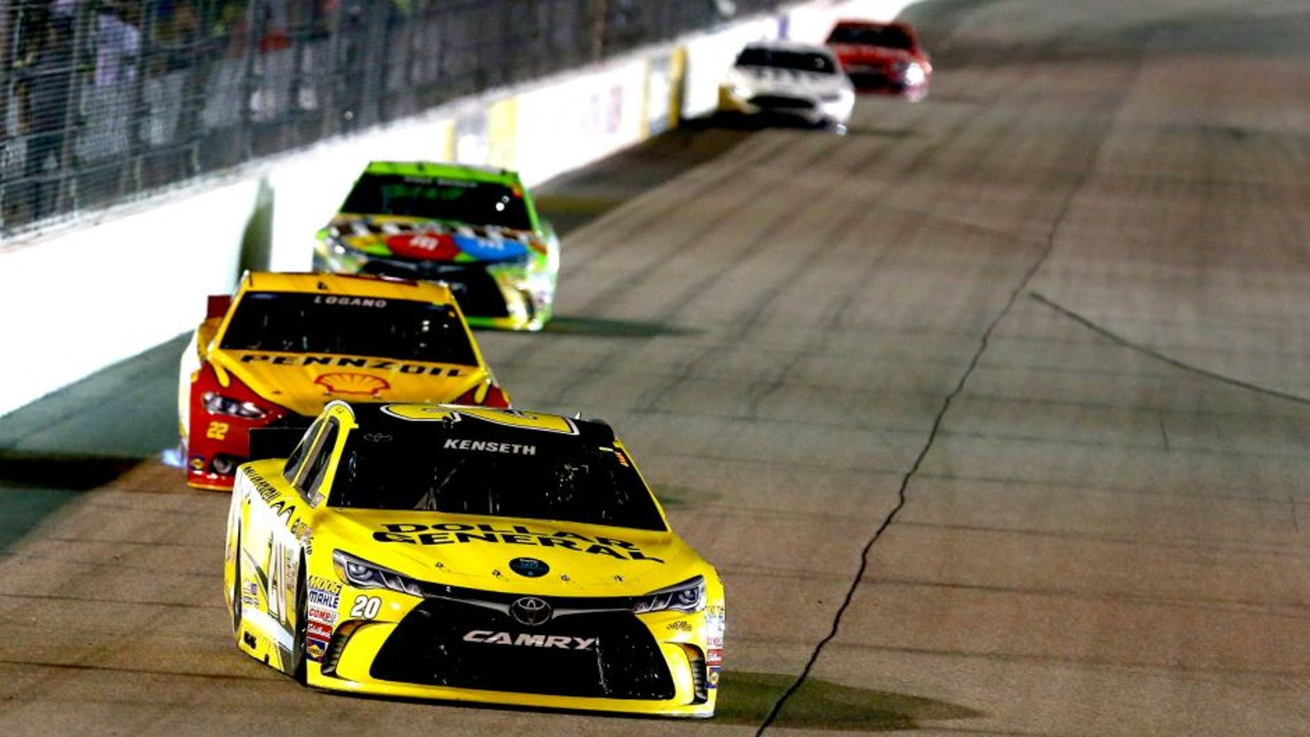 RICHMOND, VA - SEPTEMBER 12: Matt Kenseth, driver of the #20 Dollar General Toyota, leads a pack of cars during the NASCAR Sprint Cup Series Federated Auto Parts 400 at Richmond International Raceway on September 12, 2015 in Richmond, Virginia. (Photo by Sarah Crabill/Getty Images)