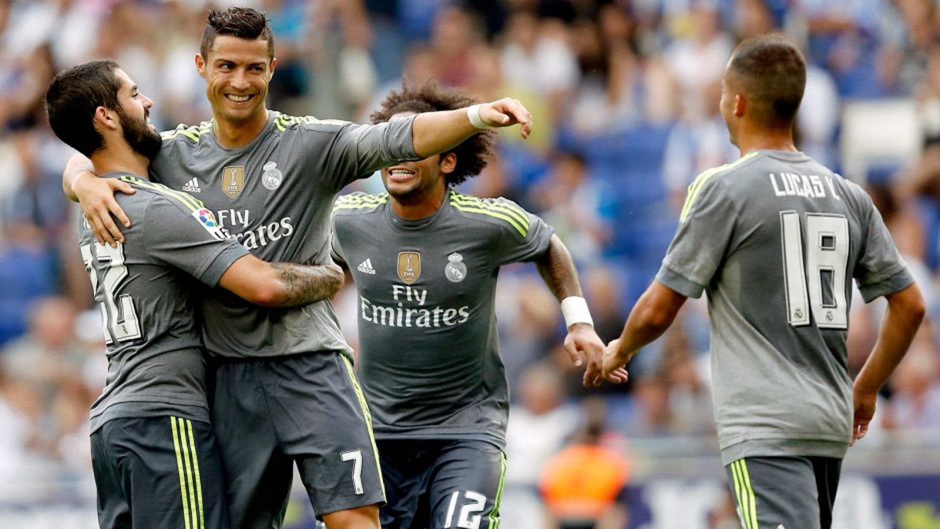 MADRID, SPAIN - AUGUST 29: Cristiano Ronaldo of Real Madrid celebrates whit his teammates after scoring a goal during the La Liga match between Espanyol and Real Madrid at Cornella-El Prat Stadium on September 12, 2015 in Barcelona, Spain. (Photo by Antonio Villalba/Real Madrid via Getty Images)