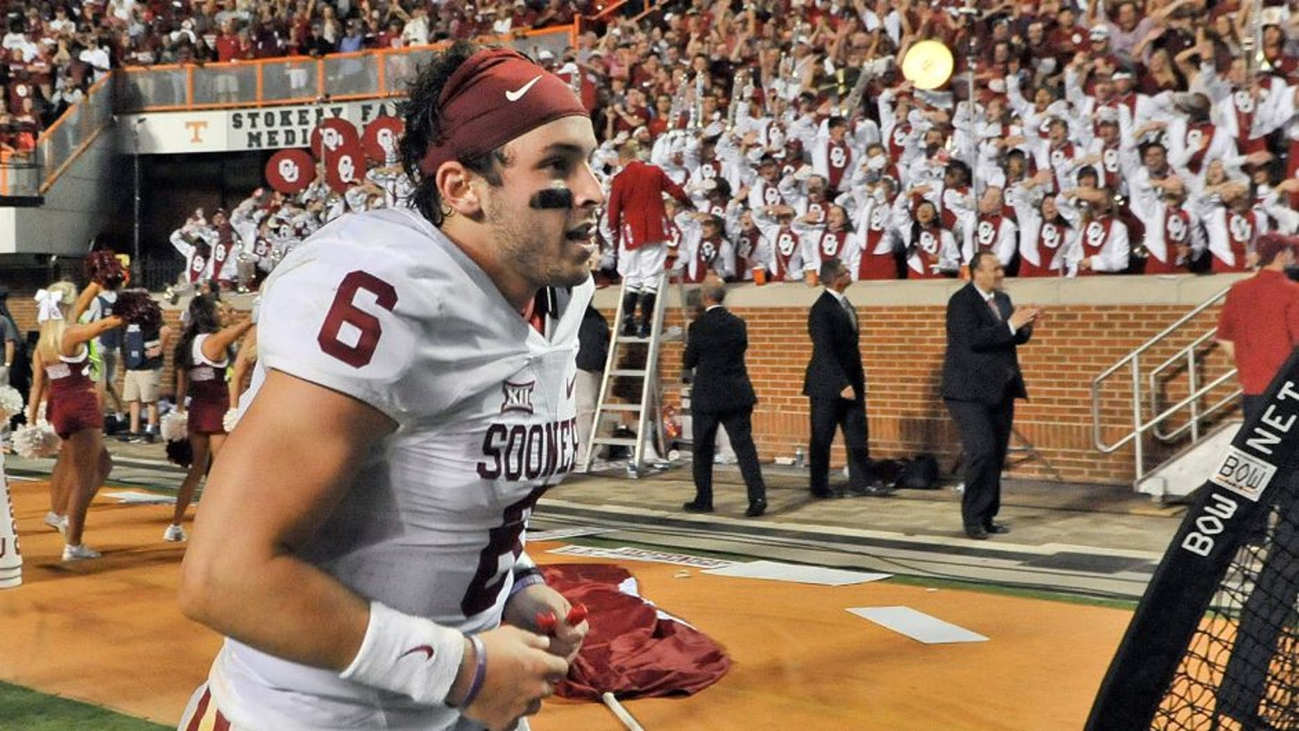 Sep 12, 2015; Knoxville, TN, USA; Oklahoma Sooners quarterback Baker Mayfield (6) runs off the field after defeating the Tennessee Volunteers in double overtime Neyland Stadium. Oklahoma won 31-24. Mandatory Credit: Jim Brown-USA TODAY Sports