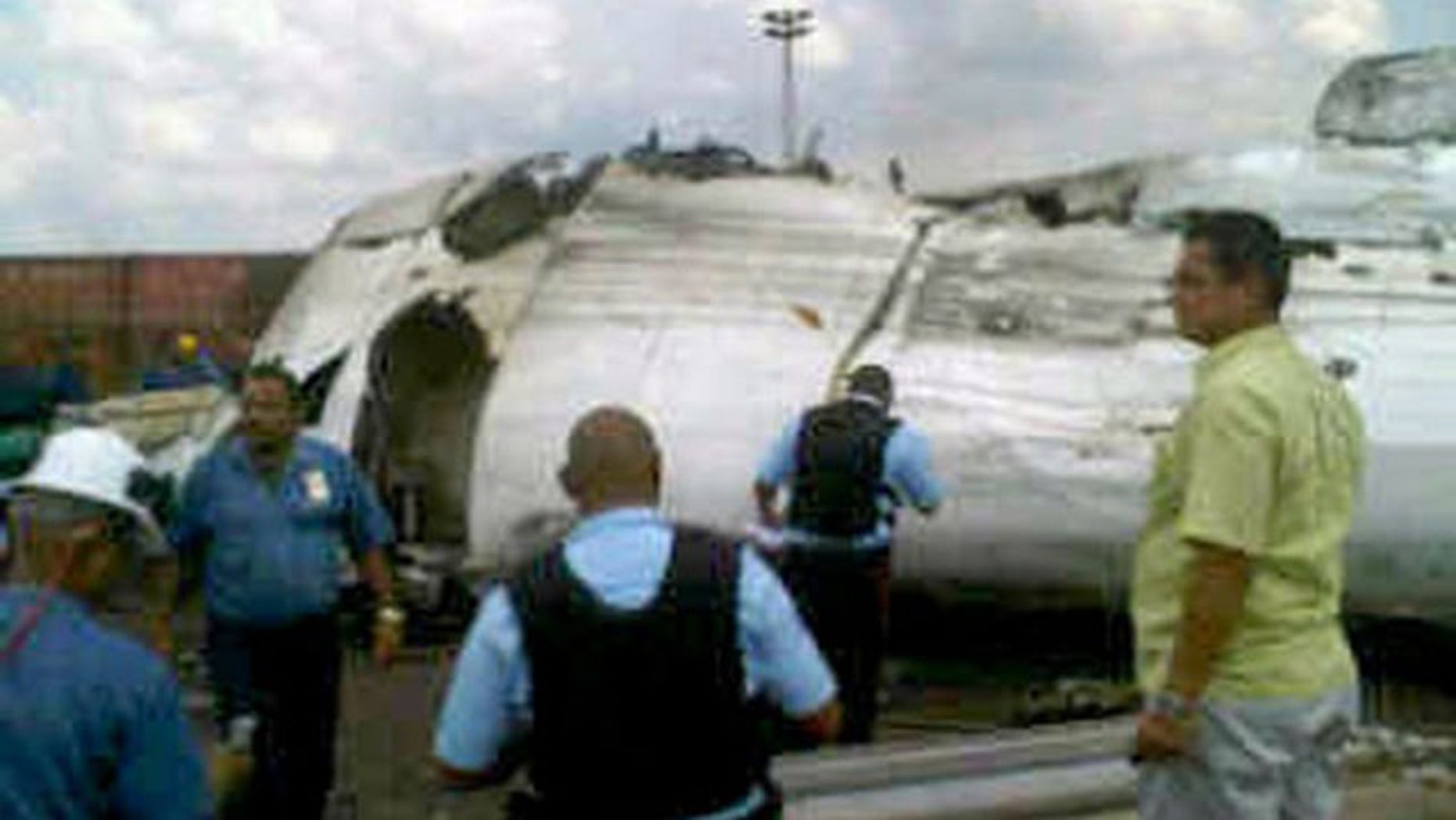 Sept. 13: A picture shows rescue workers at the place where an ATR-42 plane crashed in Puerto Ordaz. The plane owned by Venezuela's state-run airline Conviasa crashed Monday during a domestic flight with 47 people on board and came down on property belonging to government steel maker Sidor, authorities said (Reuters).