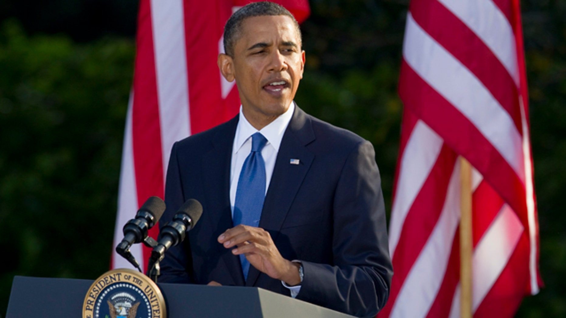 Sept. 13: President Obama gestures as he speaks to NCAA championship student athletes on the South Lawn of the White House in Washington.