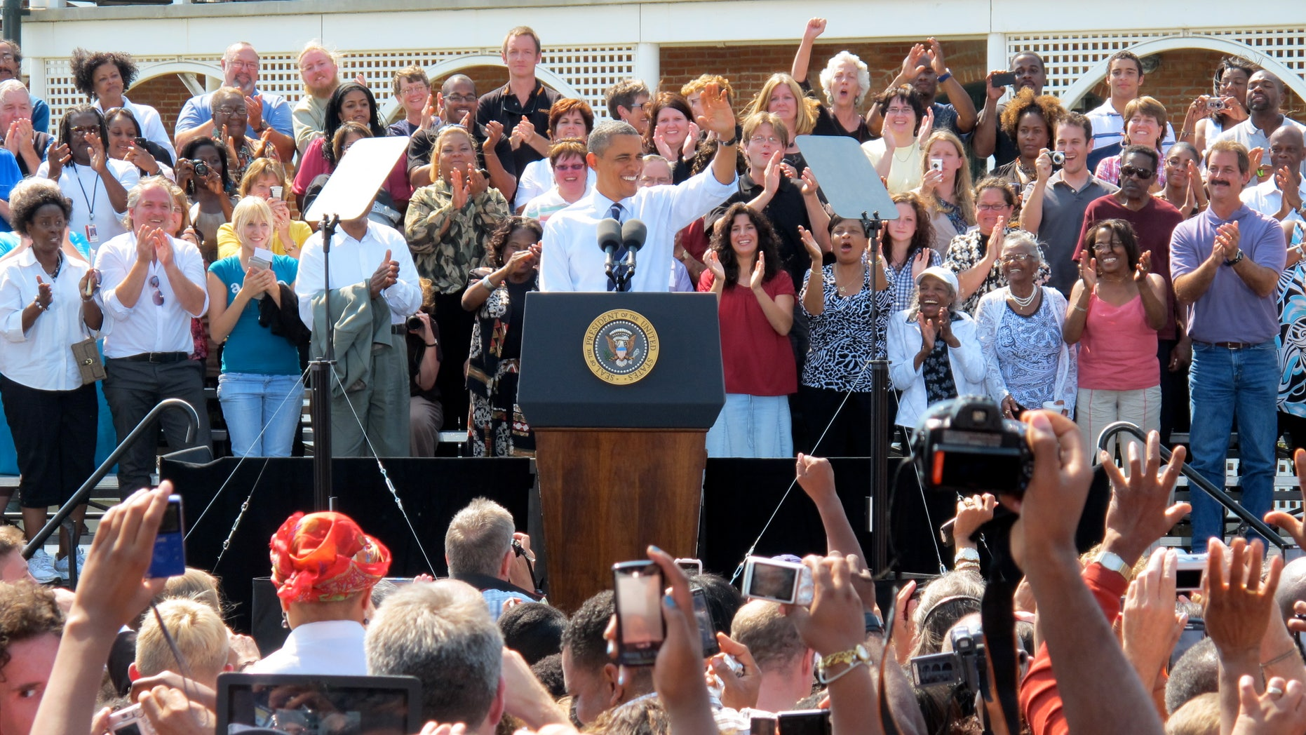 Tuesday: President Obama waves to supporters during an event at Fort Hayes Arts and Academics High School in Columbus, Ohio.