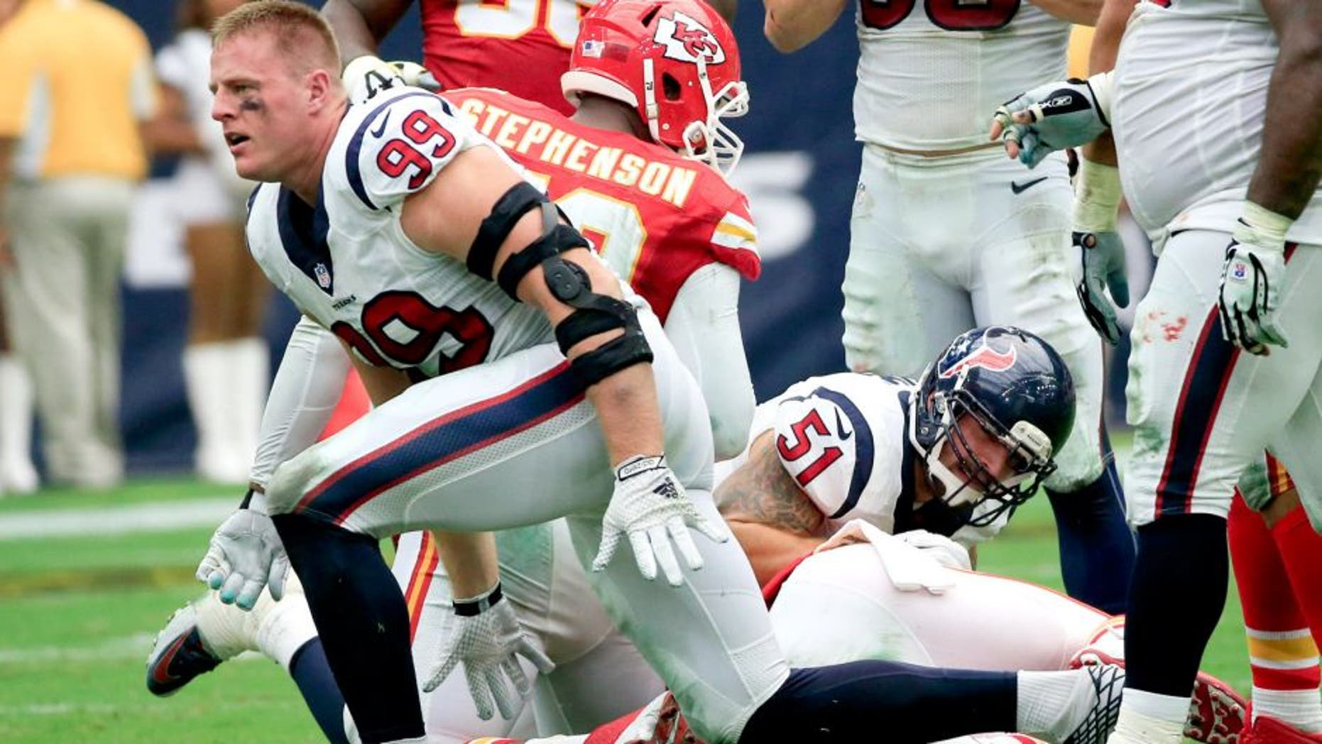Sep 13, 2015; Houston, TX, USA; Houston Texans defensive end J.J. Watt (99) reacts after making a sack during the first half against the Kansas City Chiefs at NRG Stadium. Mandatory Credit: Kevin Jairaj-USA TODAY Sports