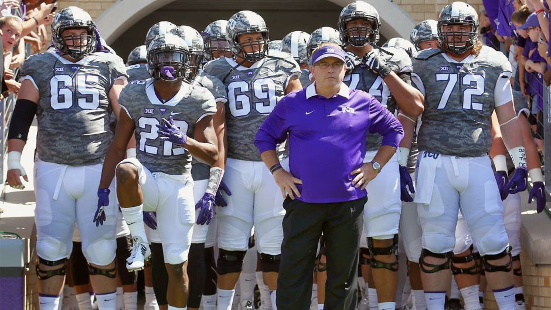 FORT WORTH, TX - SEPTEMBER 12: Head coach Gary Patterson of the TCU Horned Frogs leads his team onto the field to take on the Stephen F. Austin Lumberjacks at Amon G. Carter Stadium on September 12, 2015 in Fort Worth, Texas. (Photo by Tom Pennington/Getty Images)